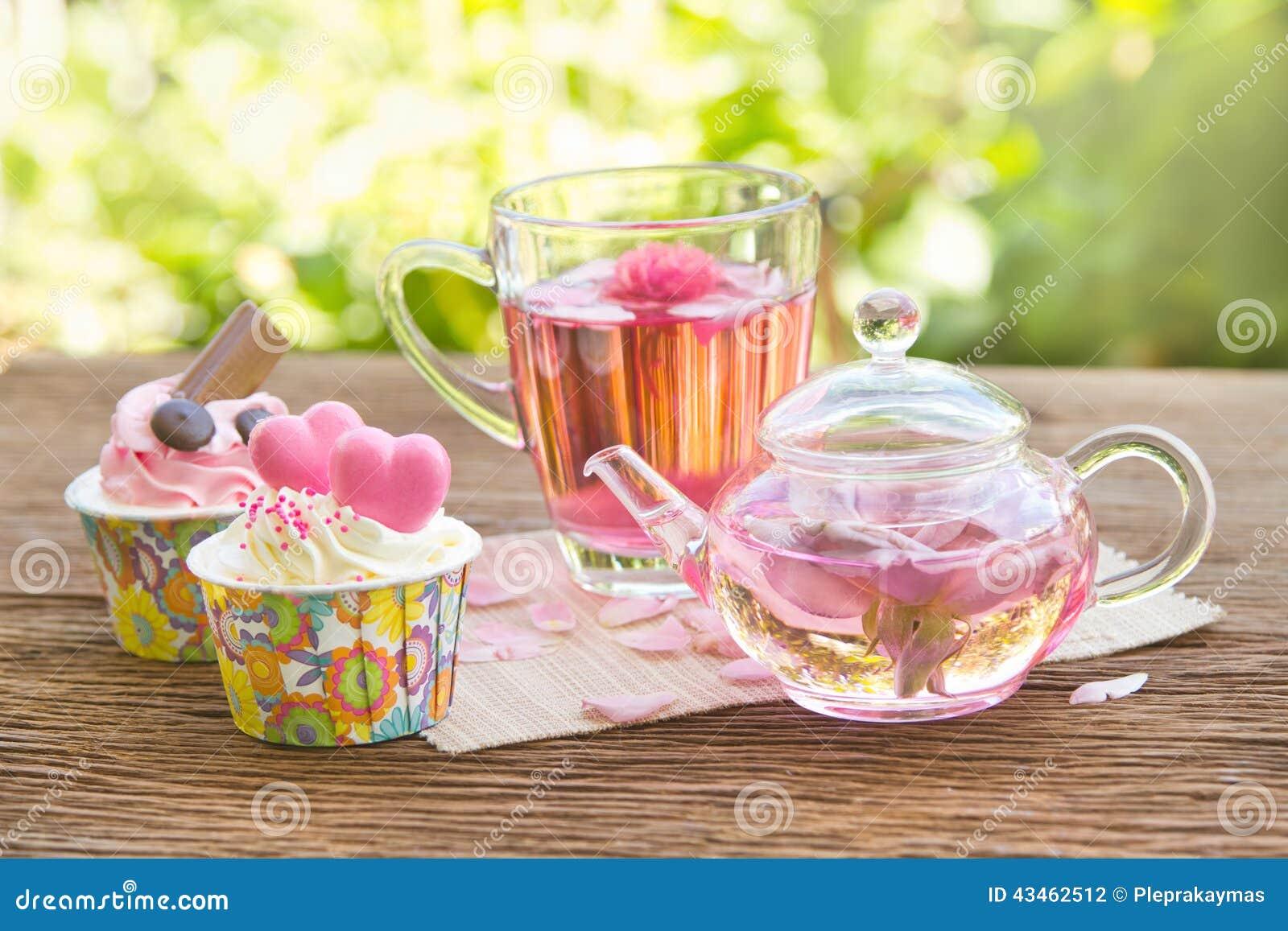 rose tea with tea pot in the garden stock photo image 43462512. Black Bedroom Furniture Sets. Home Design Ideas