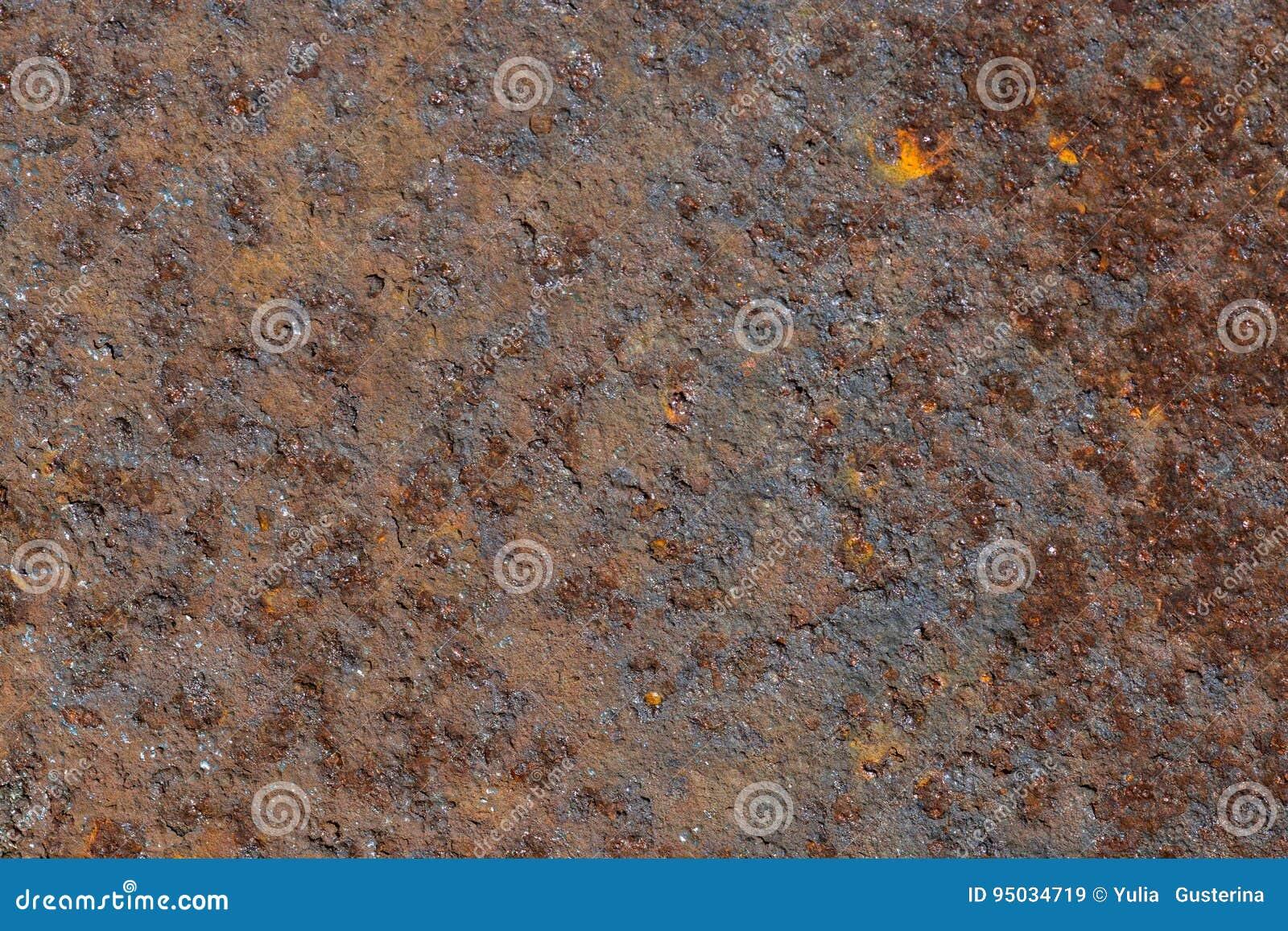 Rostad textur för bakgrund för arkmetall medf8ort