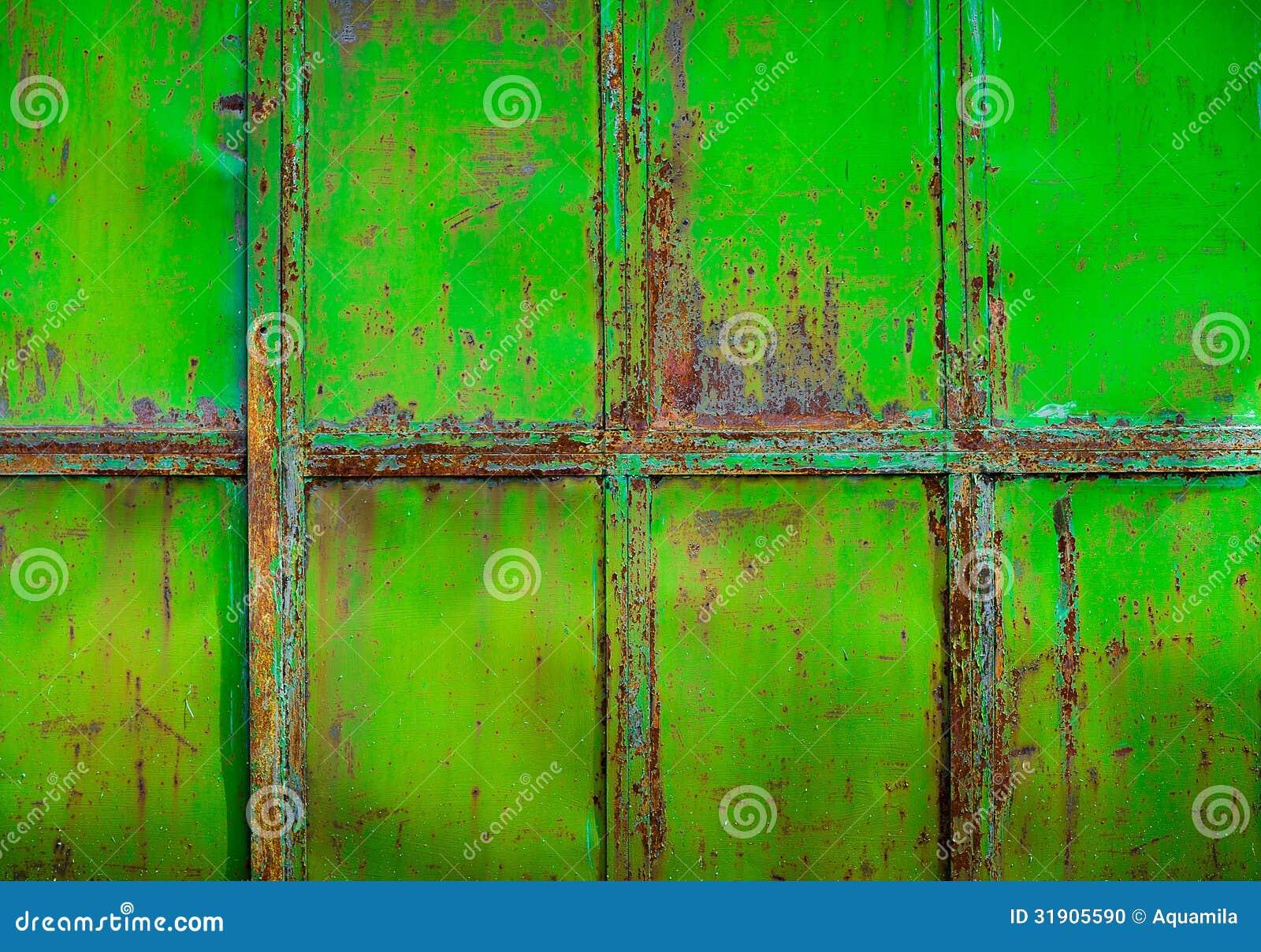 Rostig gräsplan målad metall med sprucken målarfärg, texturfärggrun
