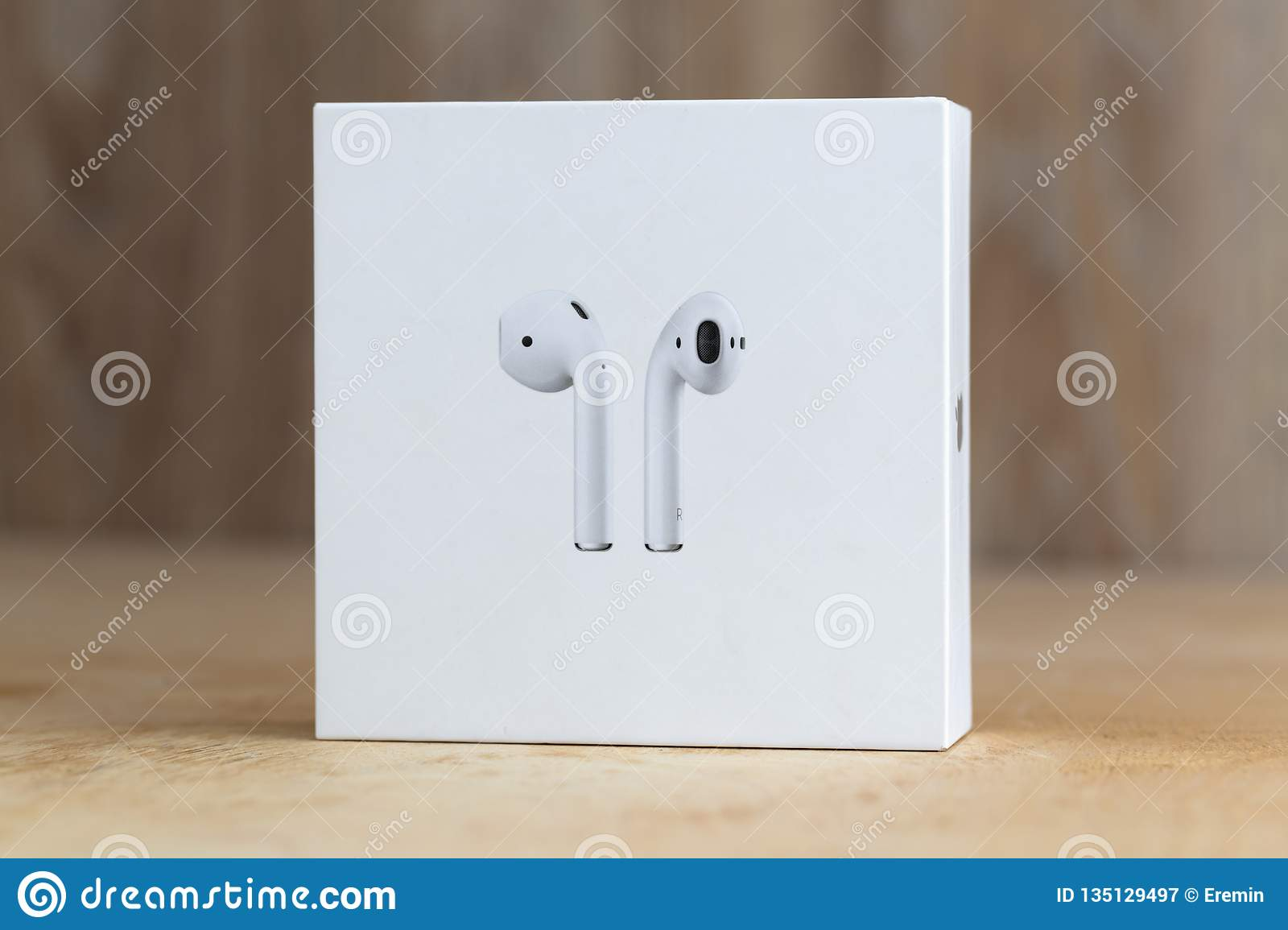 Apple Airpods In A Box On A Wooden Surface Editorial Photography