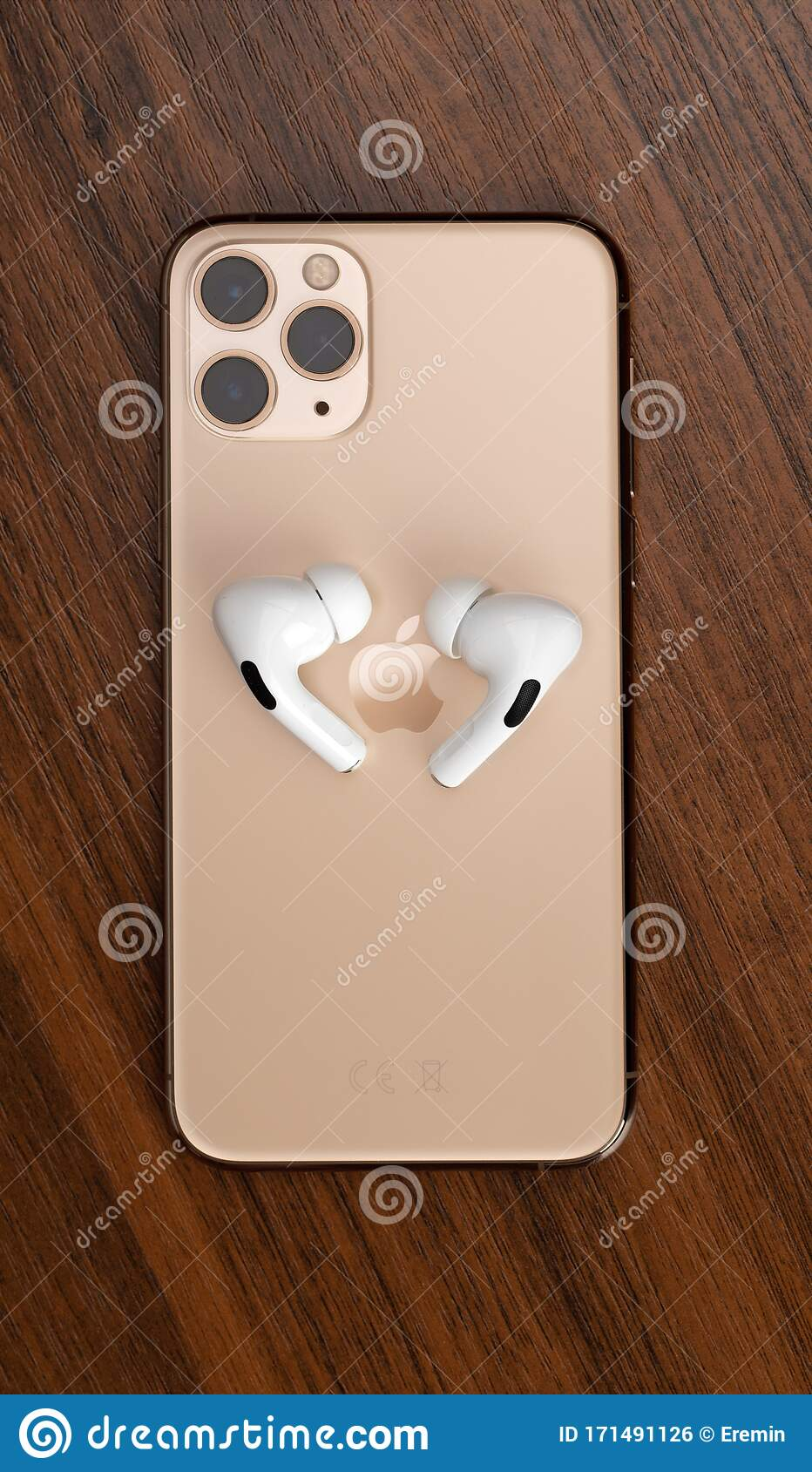 Apple Airpods Pro And Iphone 11 Pro On A Wooden Table Wireless Headphones And Smartphone Editorial Photo Image Of Headphones Cellular 171491126