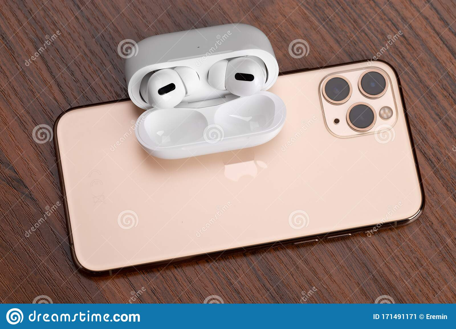 Apple Airpods Pro And Iphone 11 Pro On A Wooden Table Wireless Headphones And Smartphone Editorial Photo Image Of Display Background 171491171