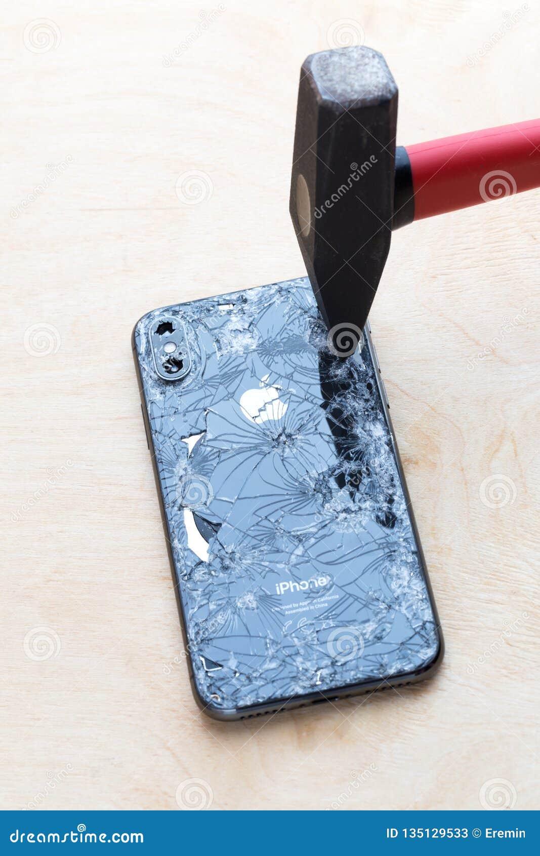 best website 9edef 2969c Broken IPhone XS Lies On A Wooden Surface. Editorial Stock Photo ...