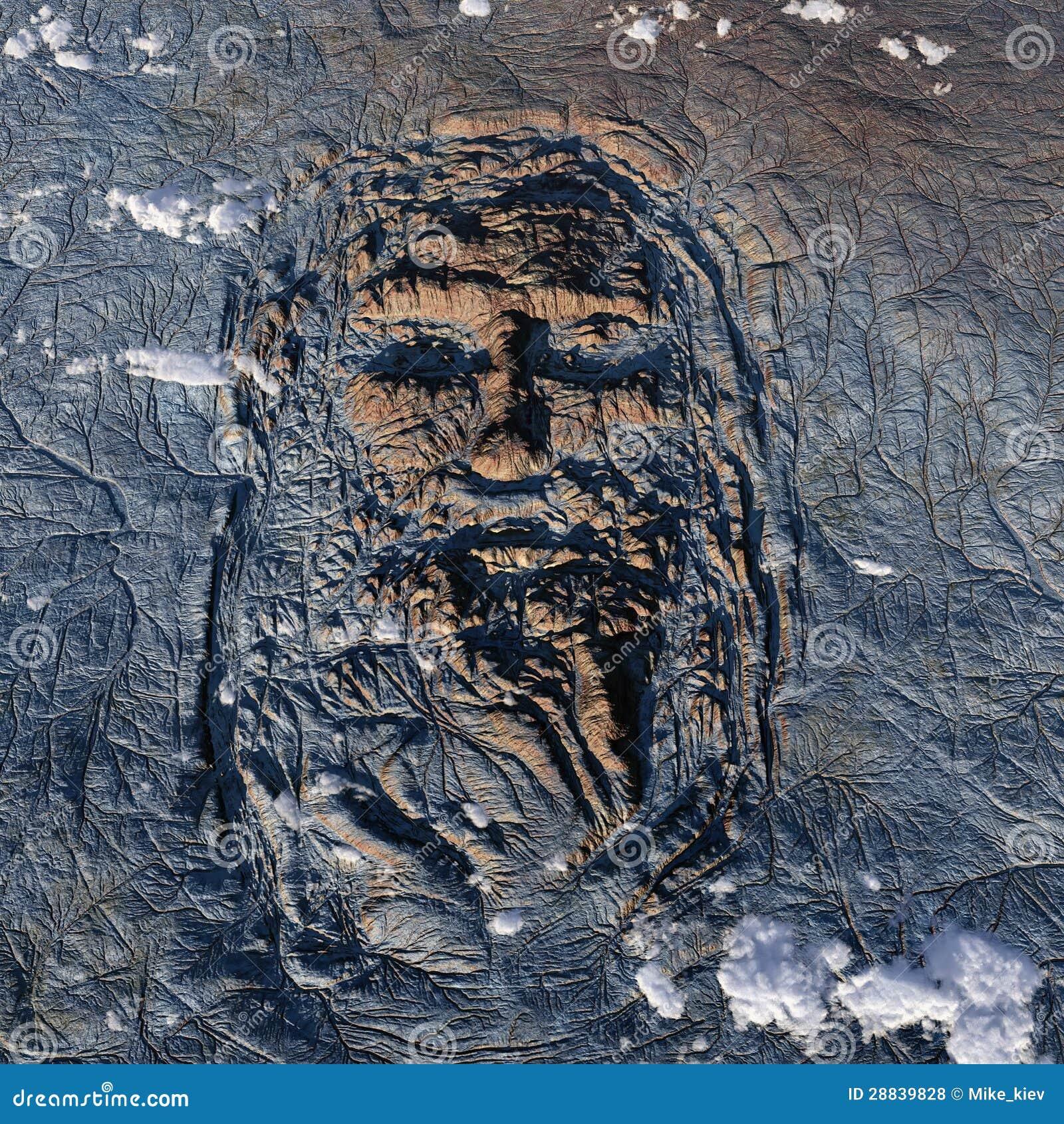Rostro humano en la tierra