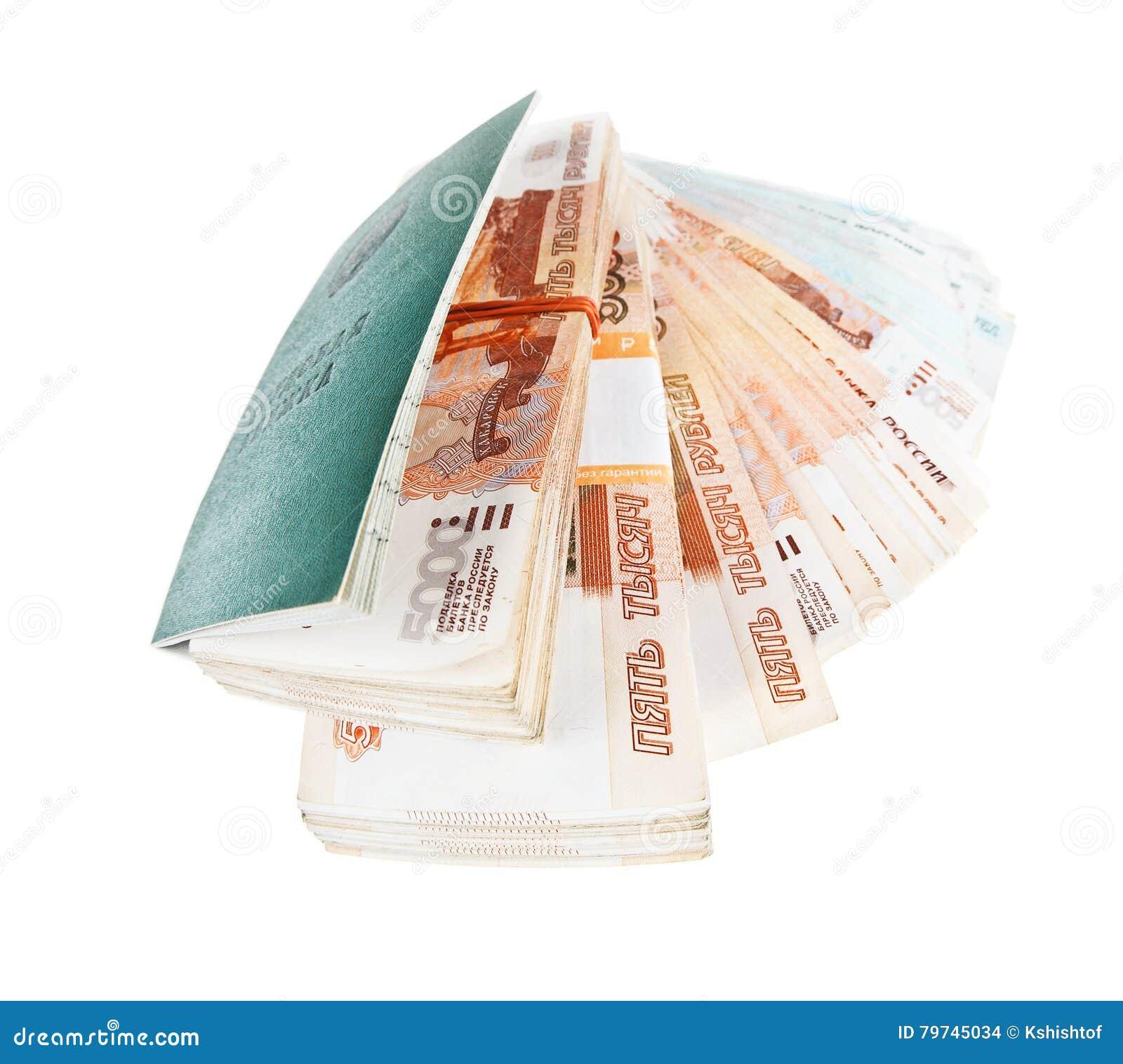 Rosyjska pracy książka i sterty banknoty