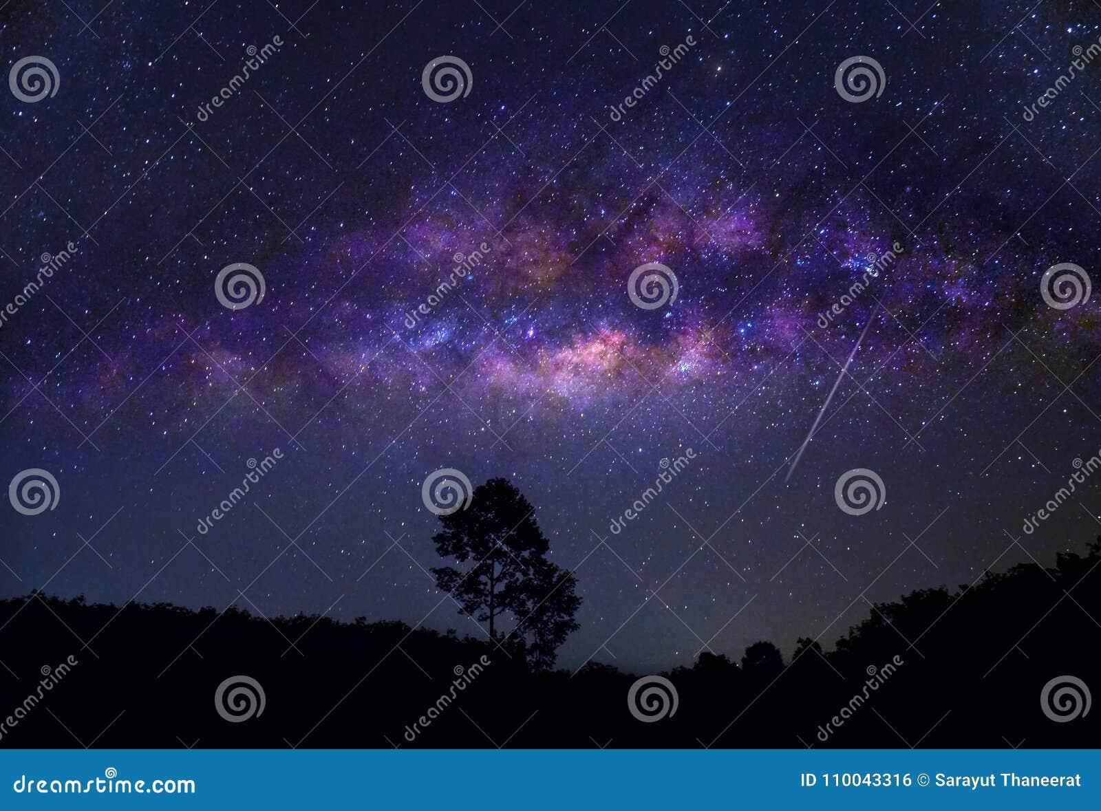 Rotating star galaxy mountain night blue sky
