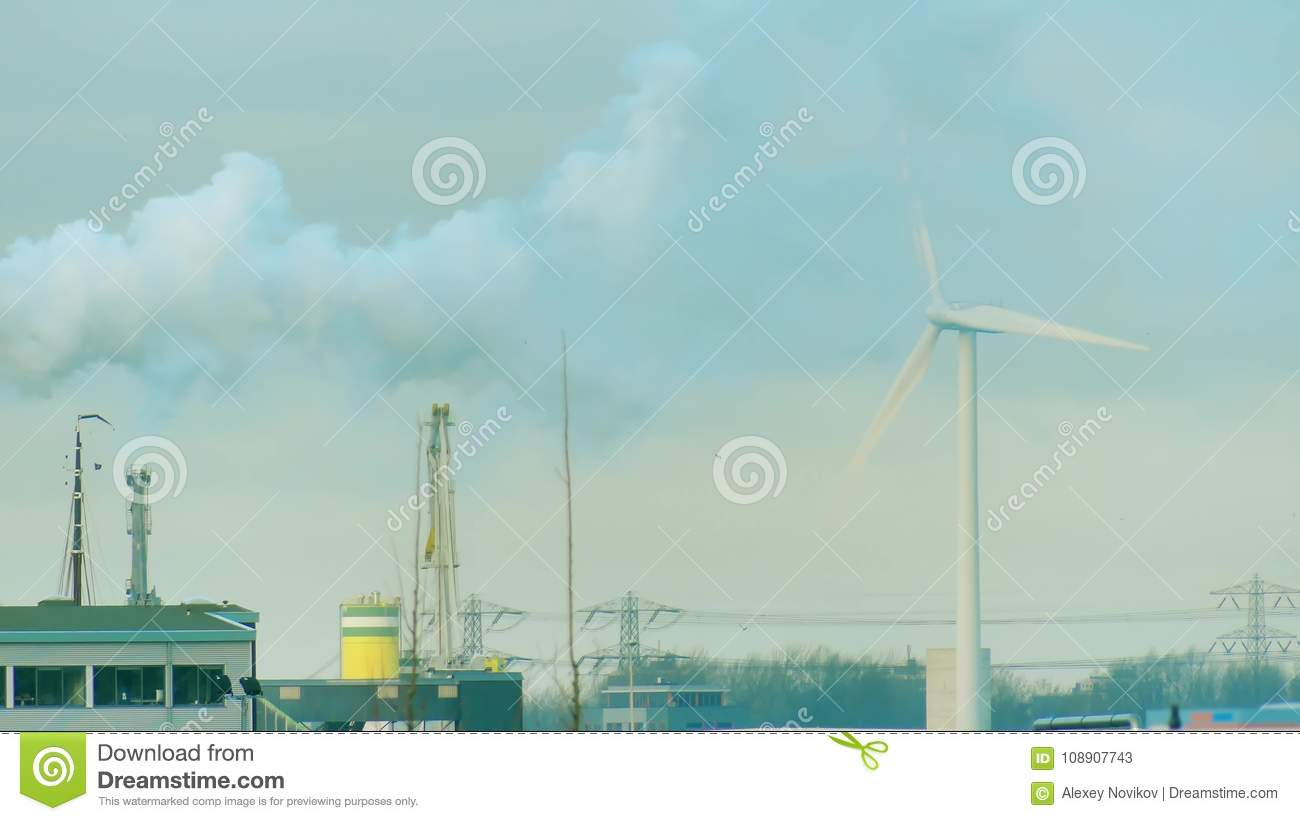 Rotating Wind Generator And Smoke Over Industrial Zone