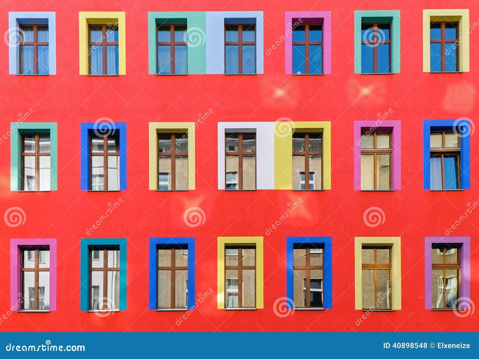 rote fassade mit bunten fenstern stockfoto bild 40898548. Black Bedroom Furniture Sets. Home Design Ideas