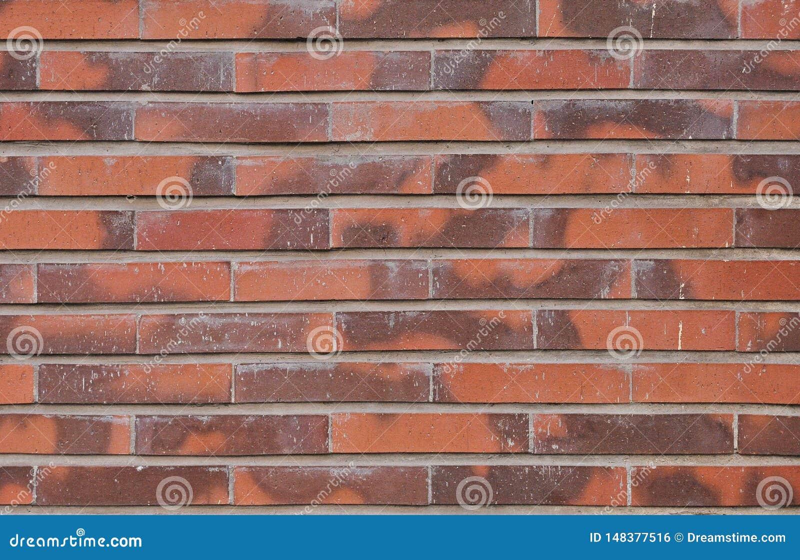 Roter Backsteinmauerbeschaffenheitshintergrund