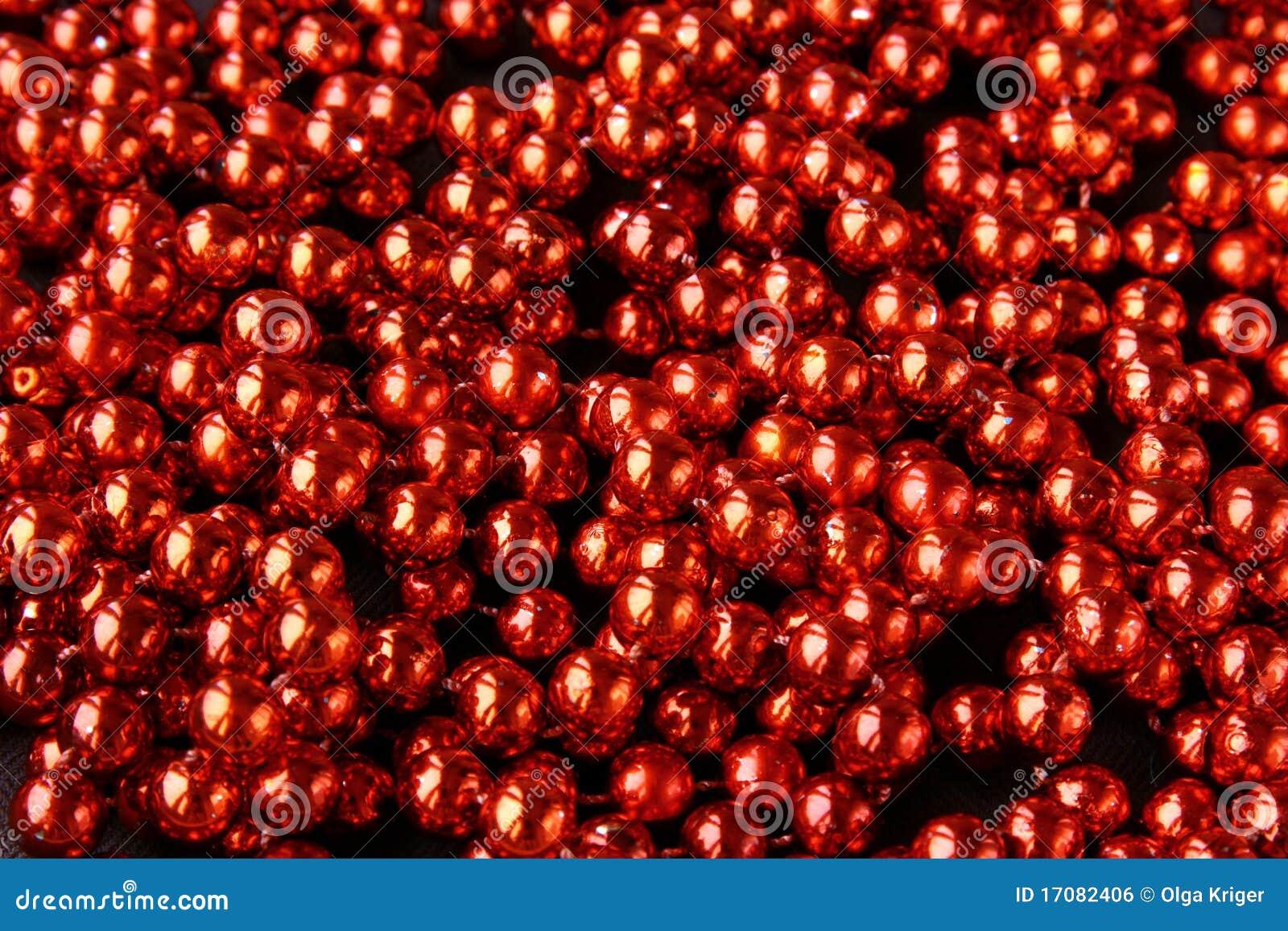 Rotes glänzendes Kostümschmucksachen backgrou