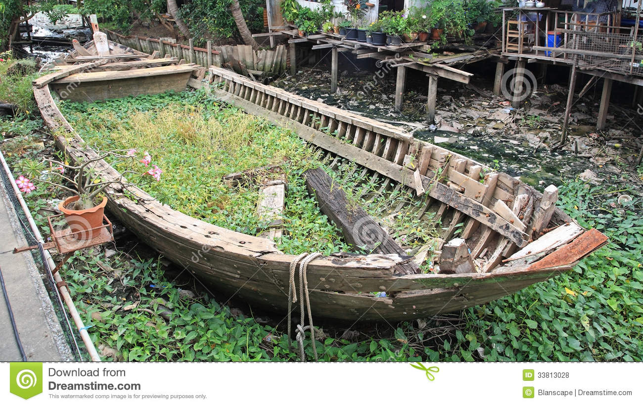 Rotted And Abandoned Row Wooden Boat Royalty Free Stock Photos - Image: 33813028