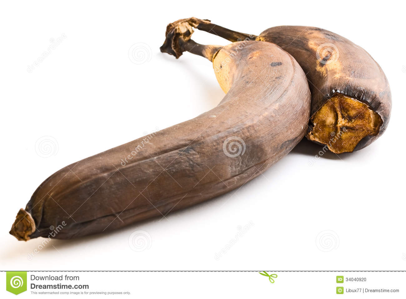 One and half rotten banana over white background.