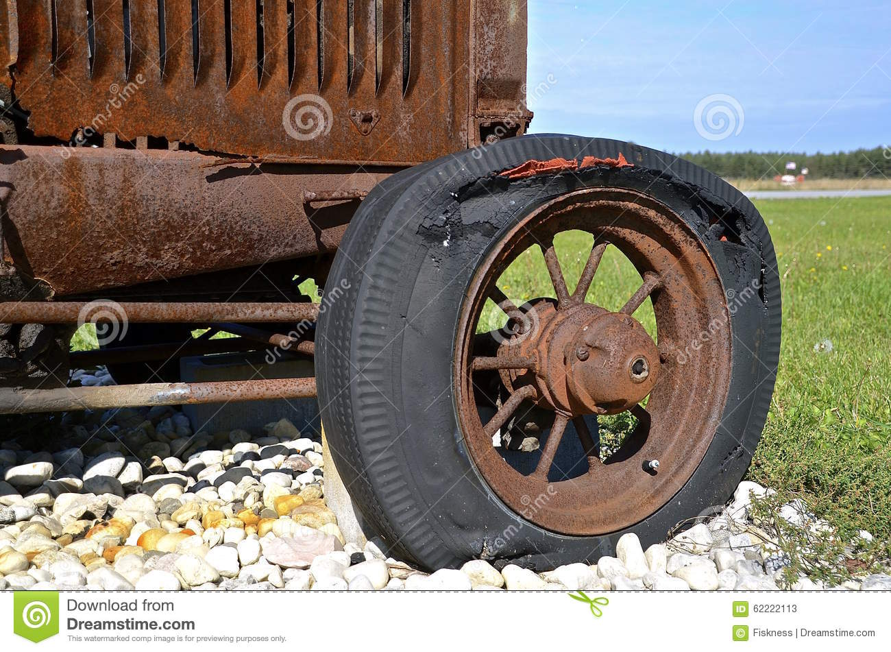 Rotten flat tractor tire stock photo image 62222113 for Scrap tractor tires