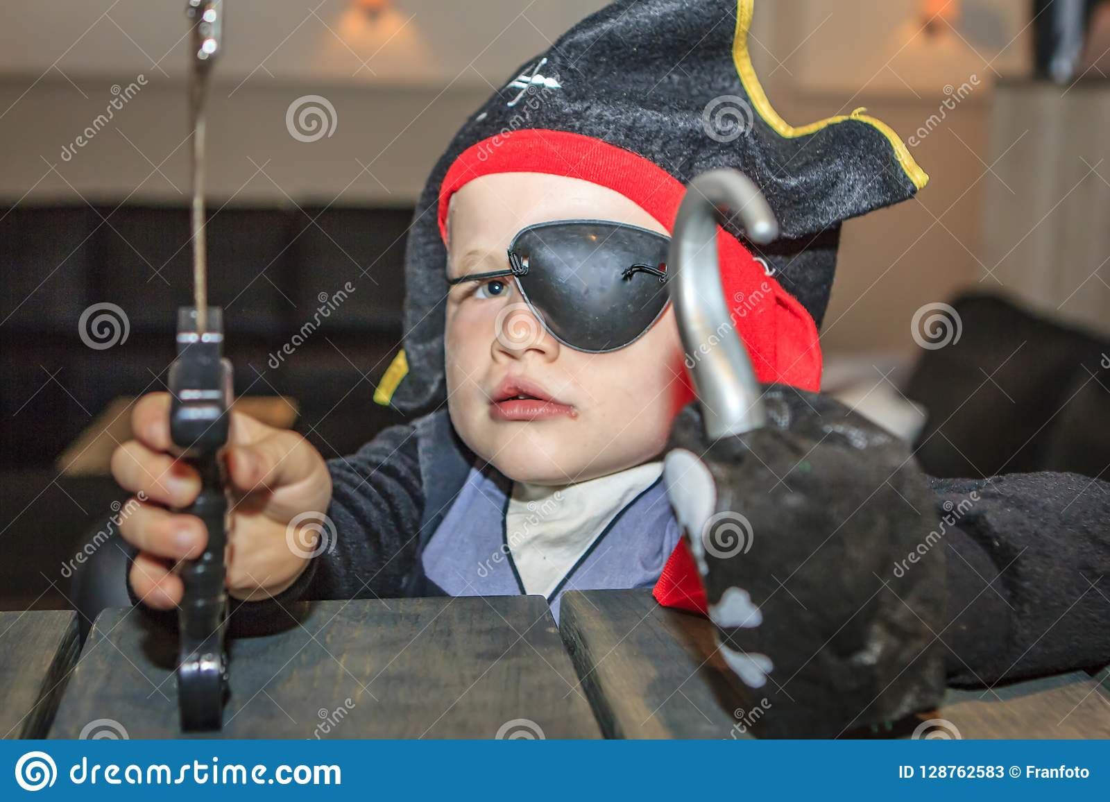 Little boy dressed as a pirate.