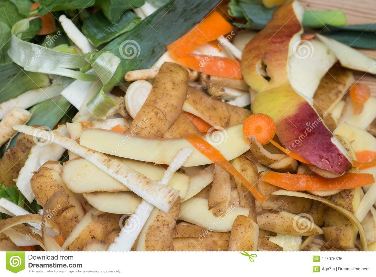 Rotting kitchen fruits and vegetable waste for compost