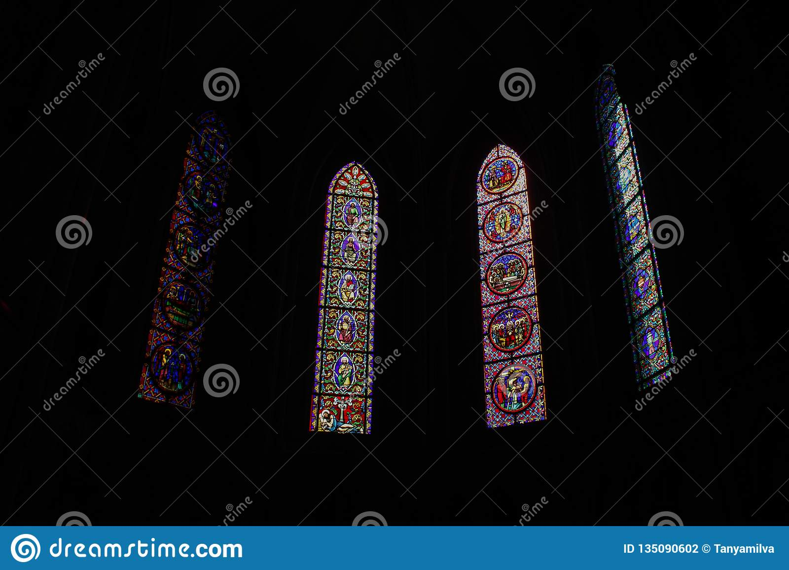 Beautiful multi-colored stained glass windows in the main Gothic cathedral of Rouen North Dame