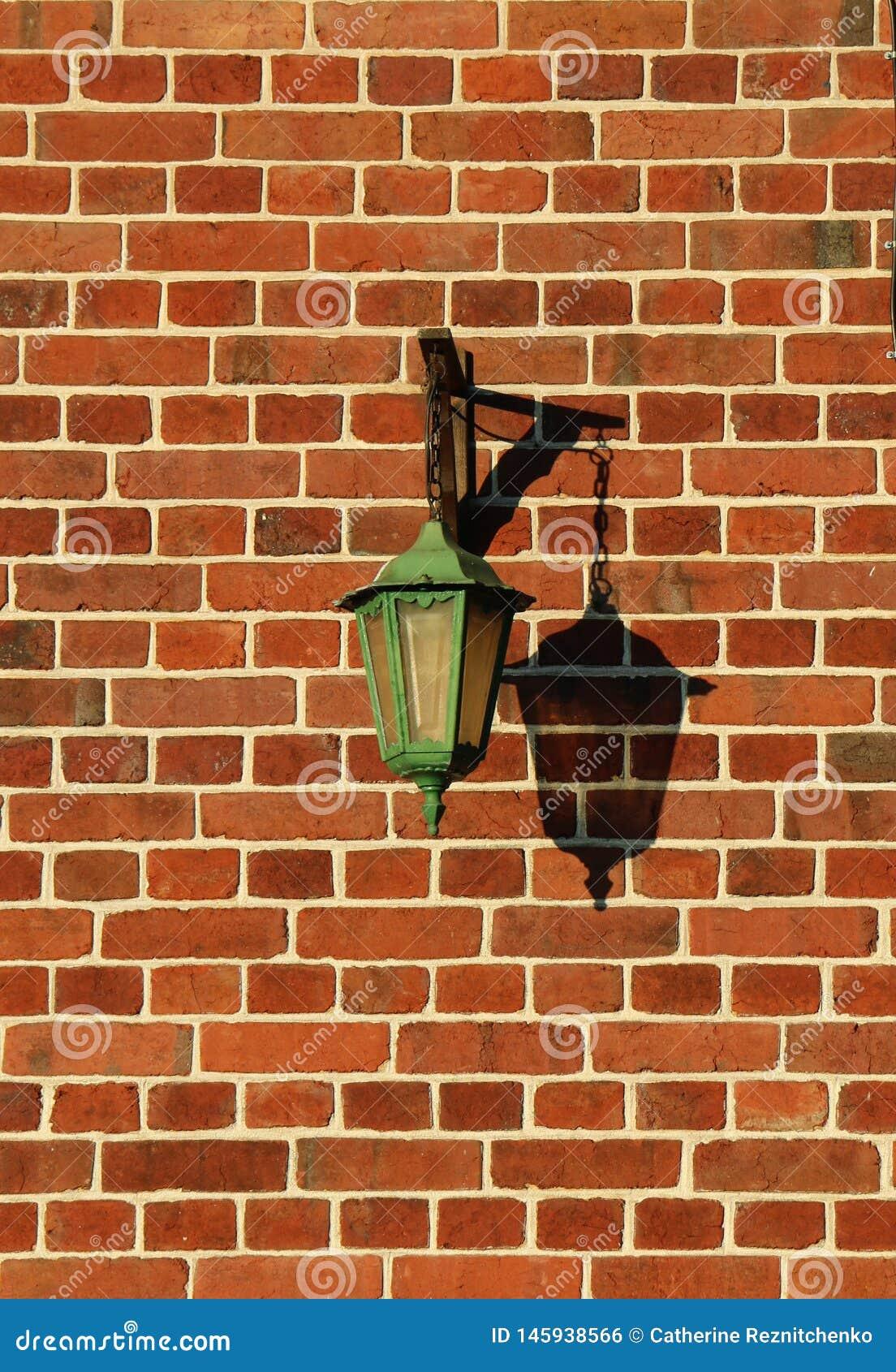 Rougar för briques för en för mur för Lampadaire normandsur