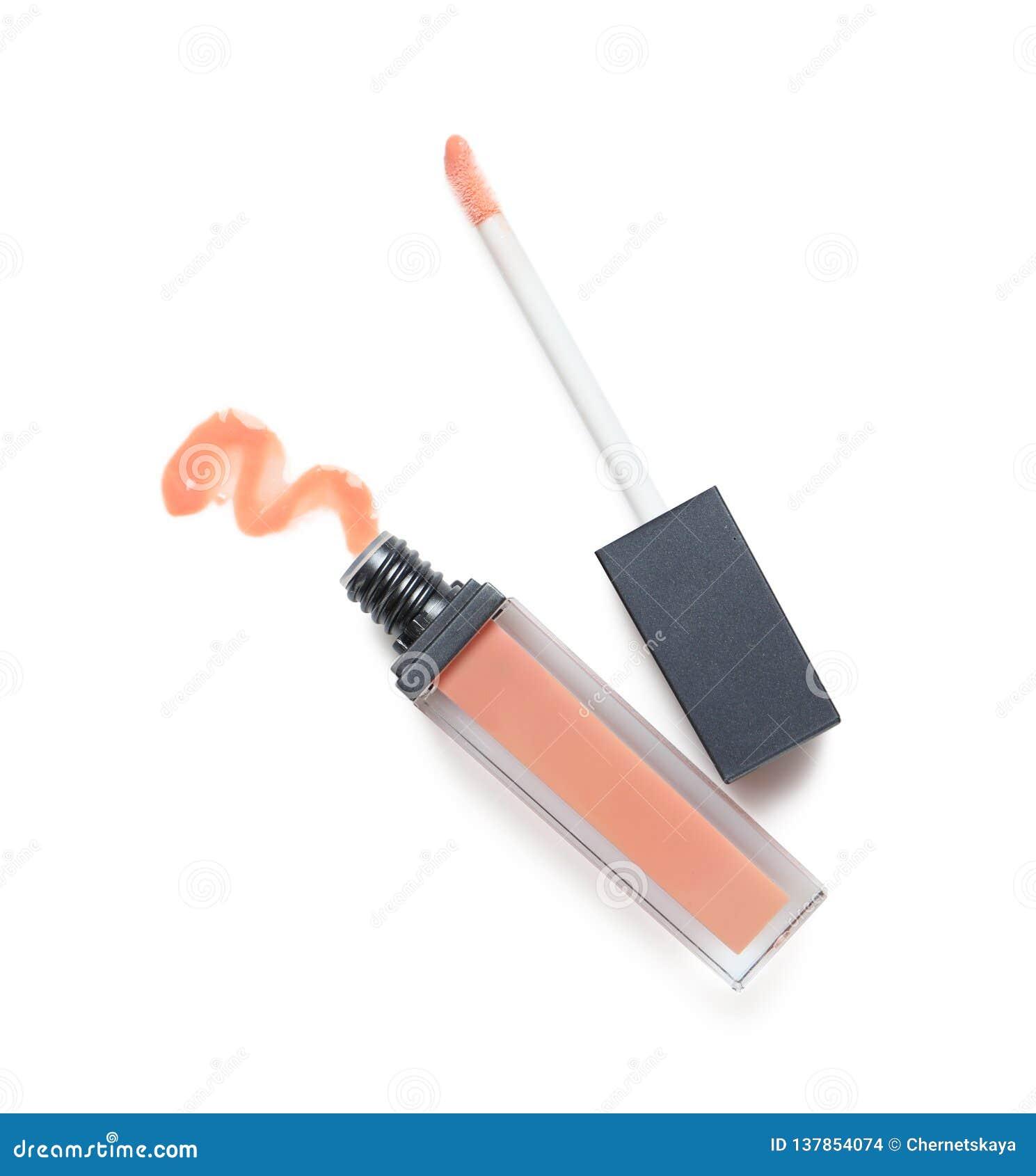 Rouge à lèvres liquide beige avec la calomnie et applicateur sur la vue blanche et supérieure