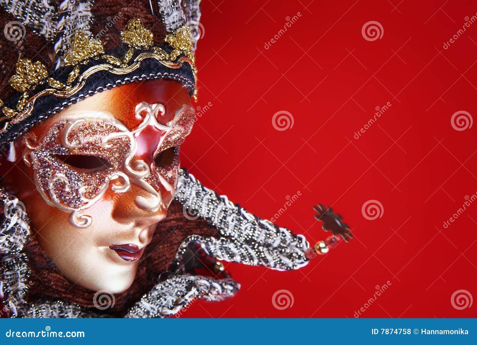 Rouge fleuri de masque de carnaval de fond