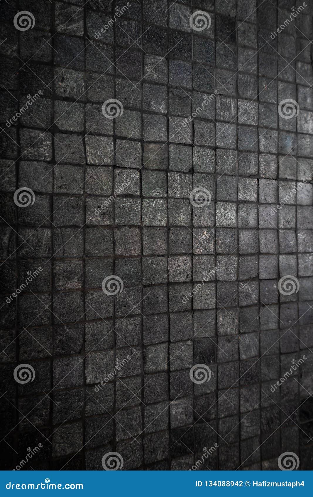 Rough dark grey mosaic tiles wall column