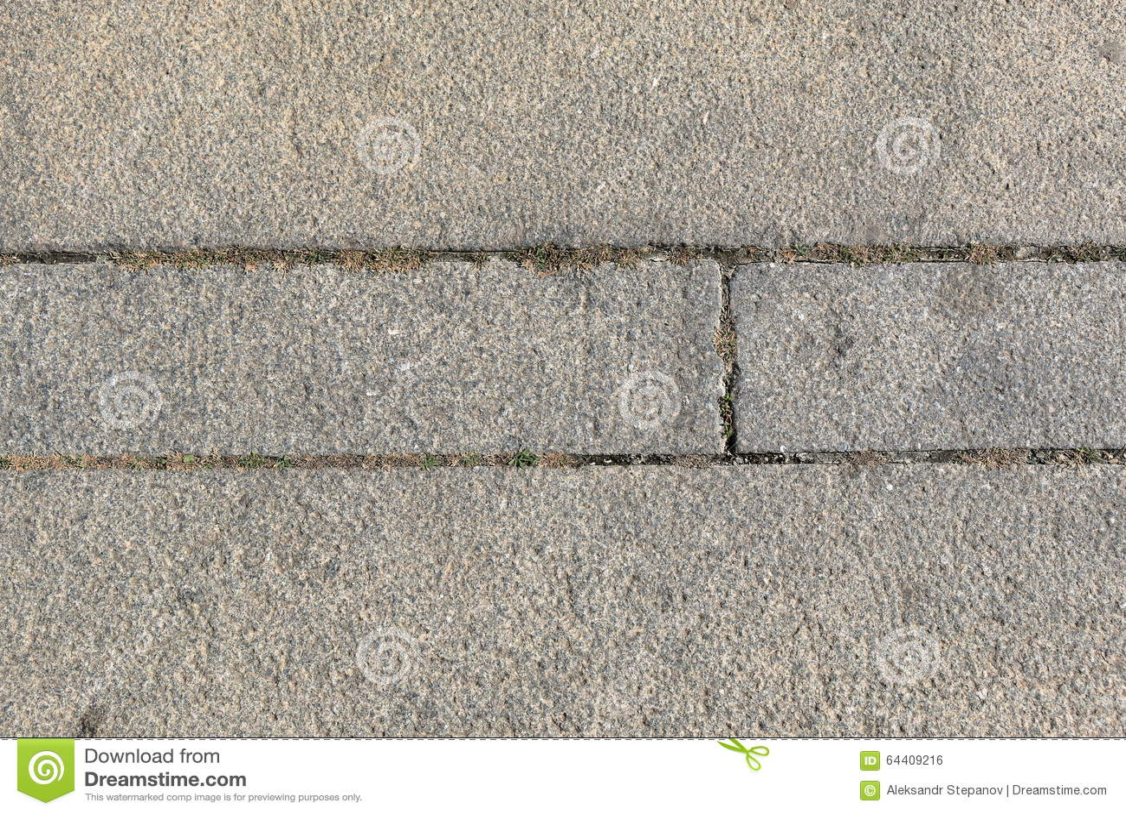 Rough Granite Block : Rough granite blocks with grass stock photo image
