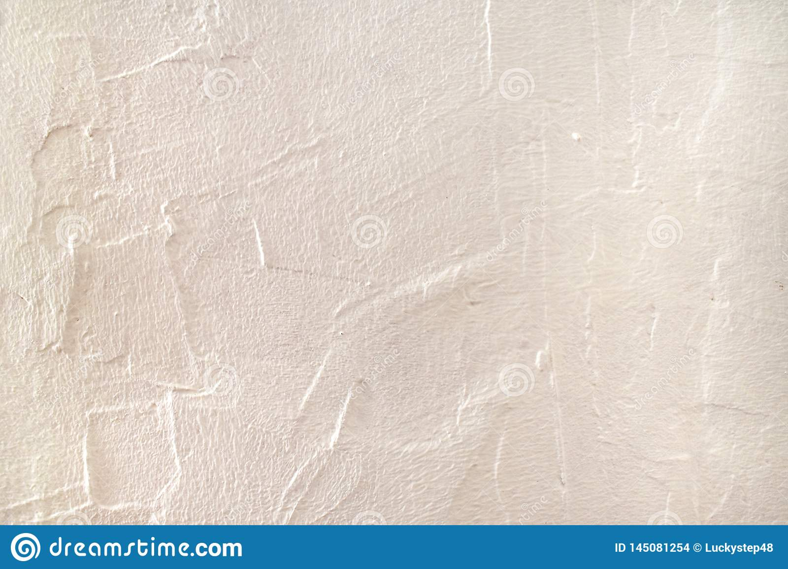 Rough surface plaster texture. Peachy pink light orange color background with copy space. Decorative plastering textured
