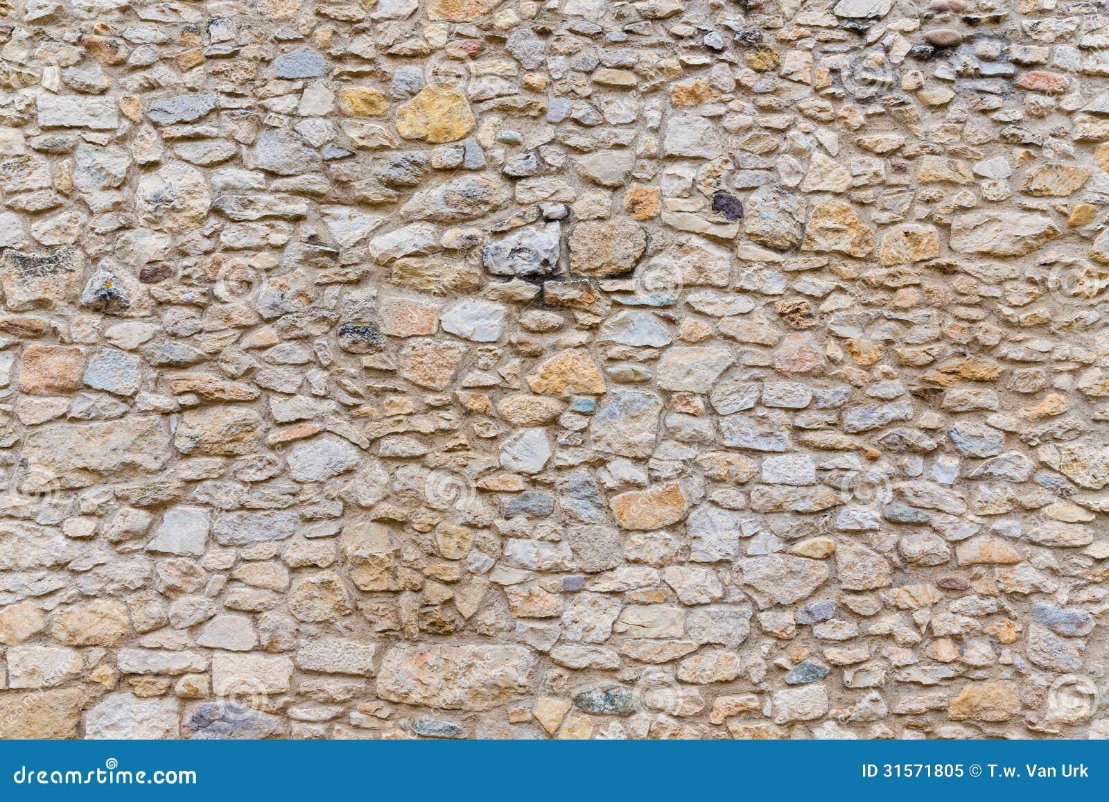 Rough Granite Block : Rough textured old stone block wall royalty free stock