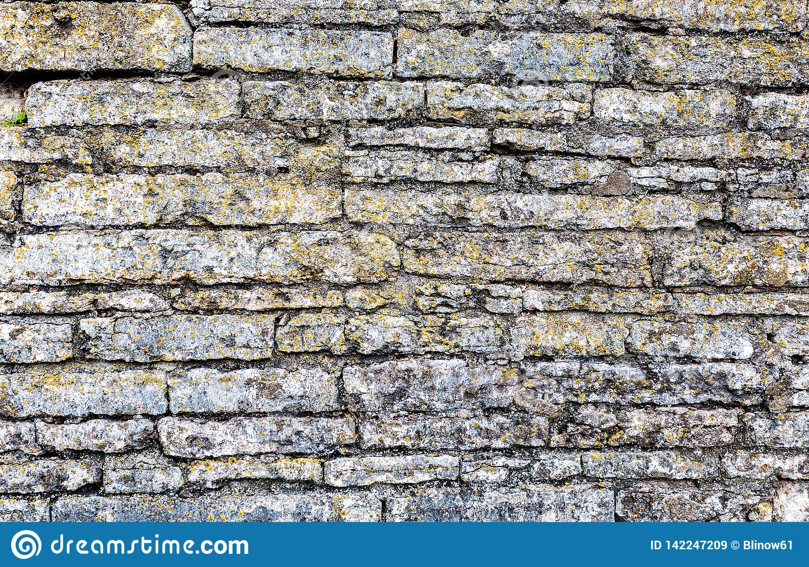 Rough weathered stone wall as background texture
