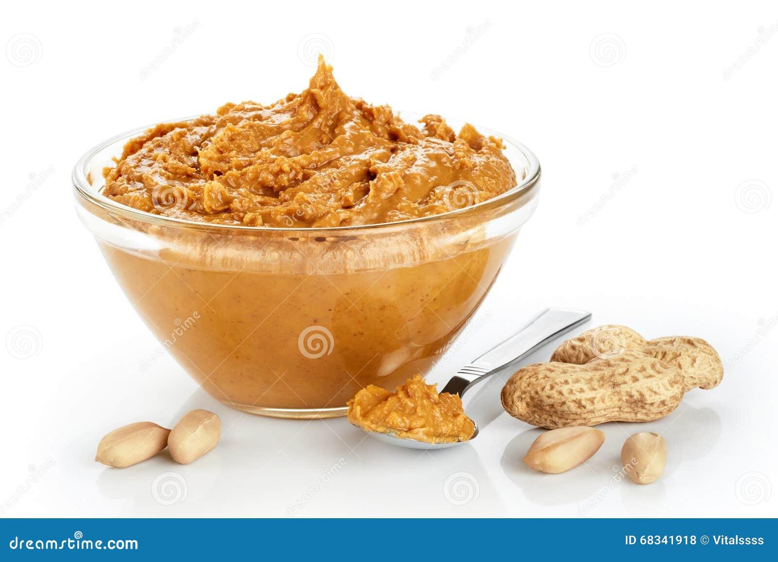 Roulez avec le beurre et les arachides d arachide d isolement sur le fond blanc