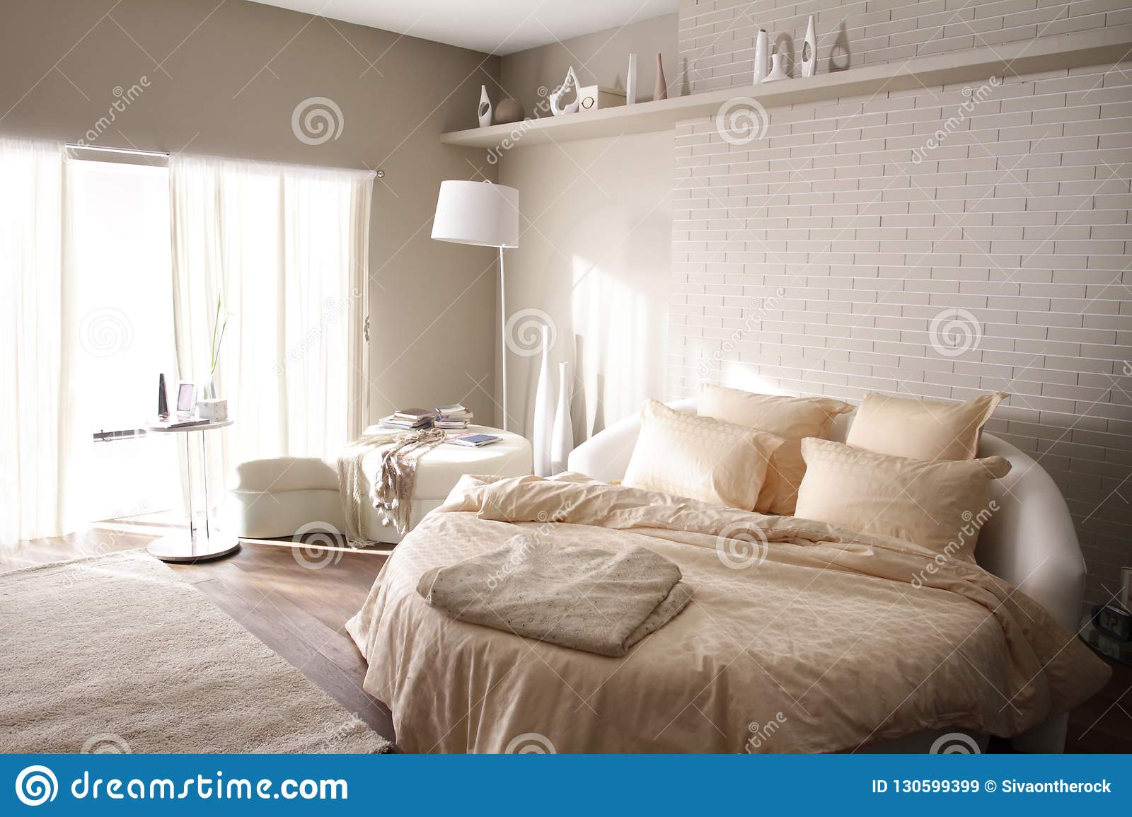Round bed in beige bedroom stock image. Image of relax ...