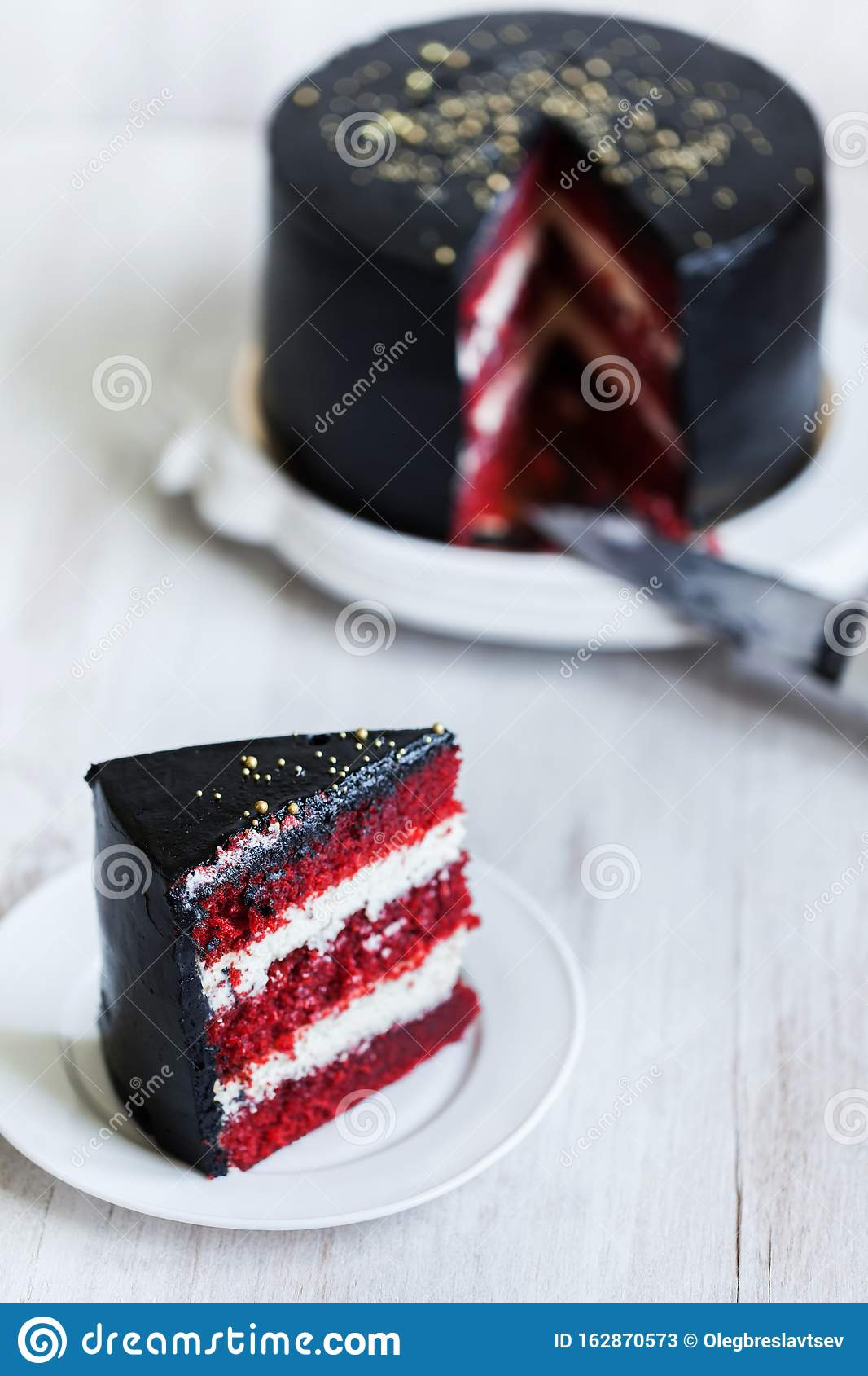Astounding Round Black Cake With Striped Red And White Filling Stock Image Funny Birthday Cards Online Amentibdeldamsfinfo
