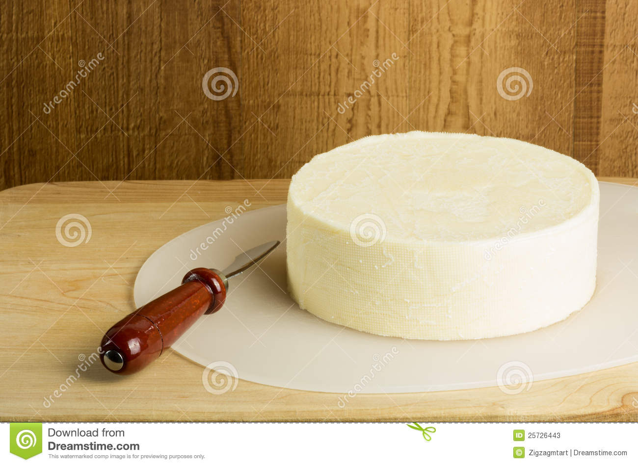 Round Block Of Cheese With Knife Stock Image Image 25726443