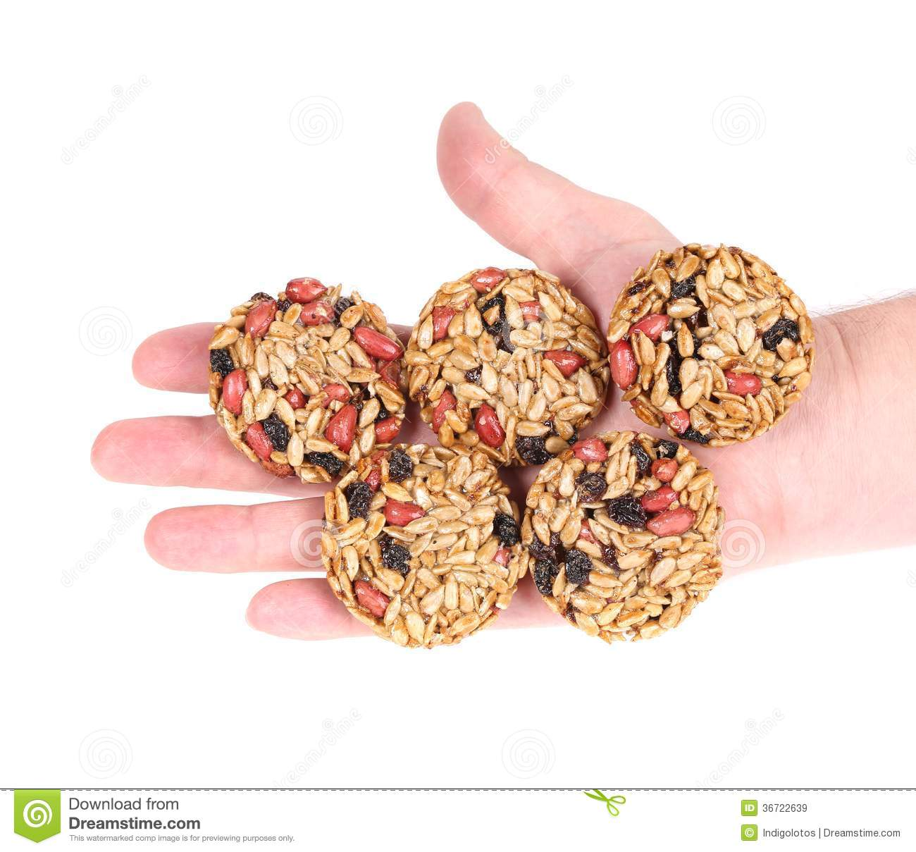 Round candied seeds and nuts in hand.