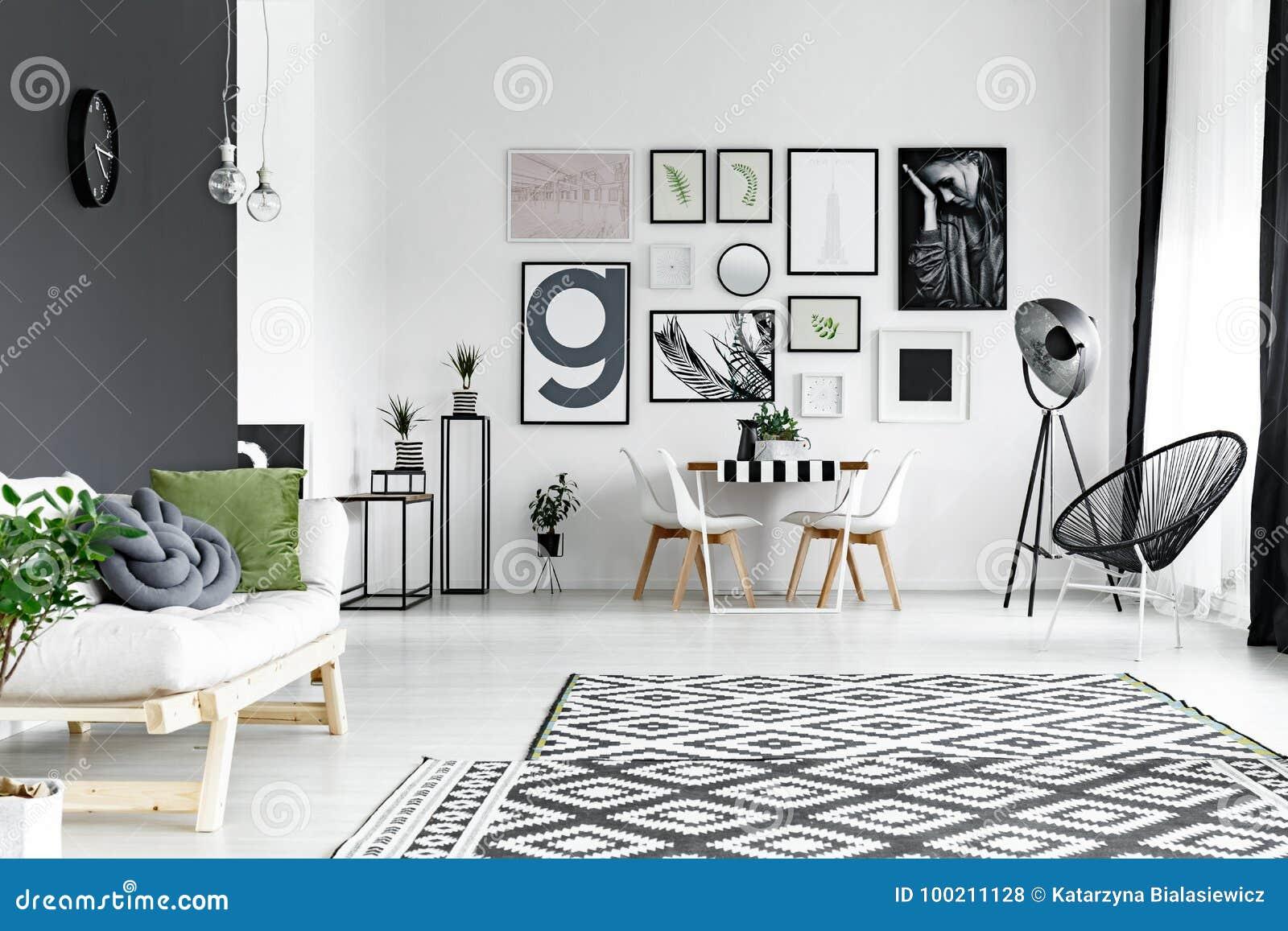 Clock on black wall stock photo. Image of interior, living - 100211128