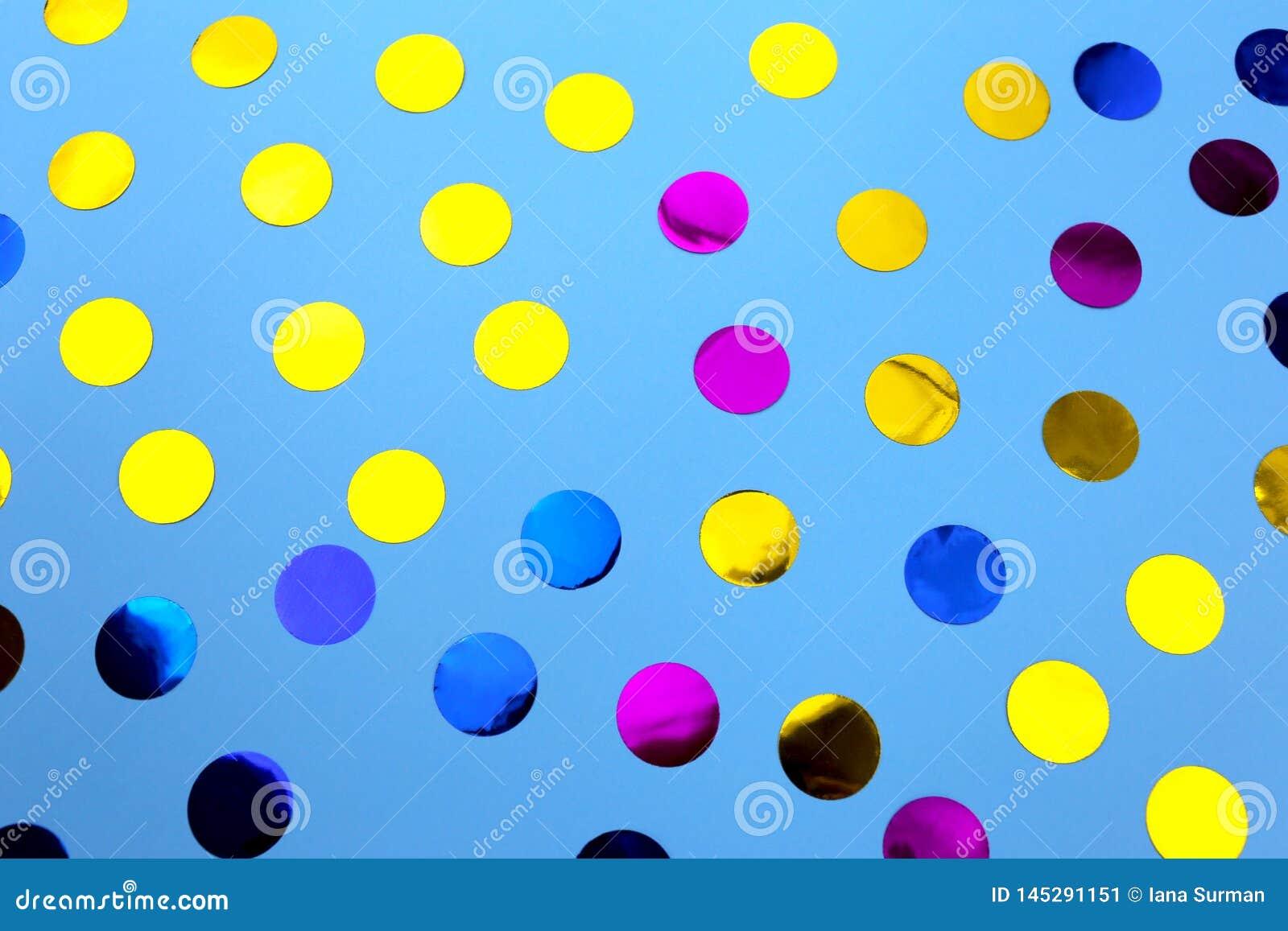 Round confetti on blue background.