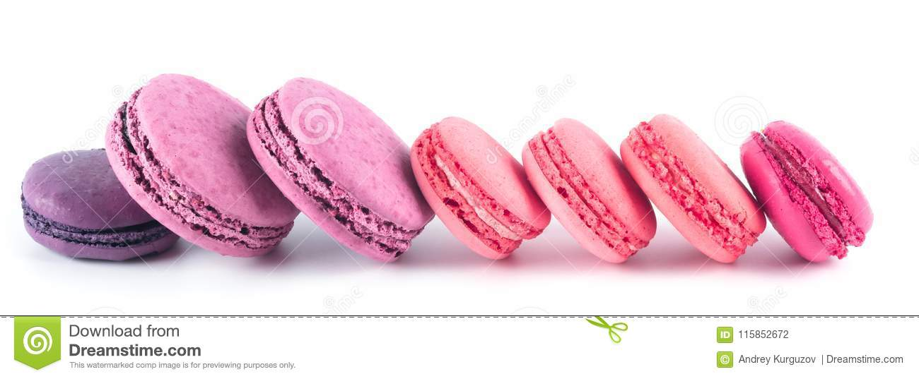 Round cookies of pink and blue color lie in a row