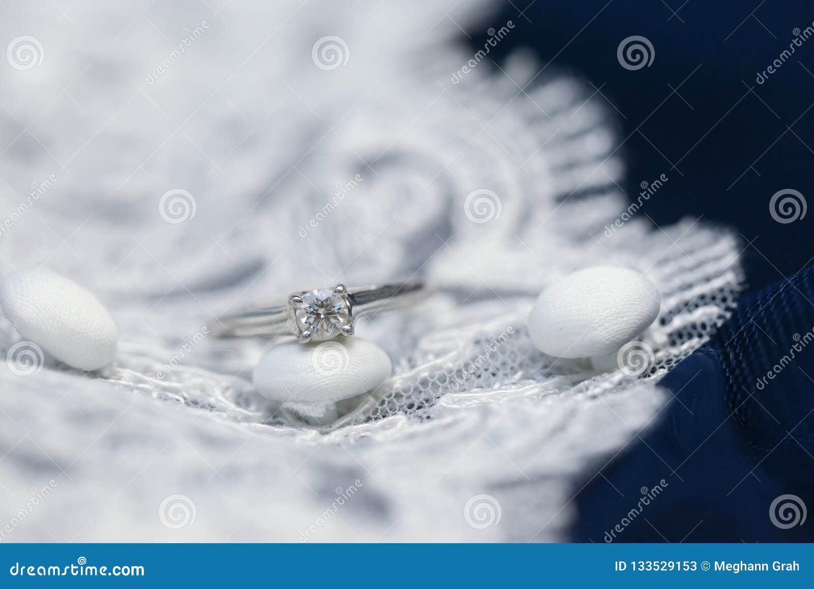Diamond Wedding Ring On Lace Wedding Dress Stock Image Image Of