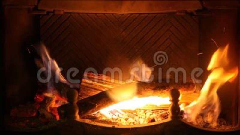 Round firewood burn in ancient fireplace HD video