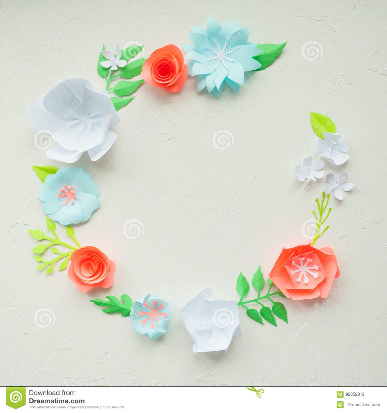Round Frame With Color Paper Flowers On The White Stucco Flat Lay