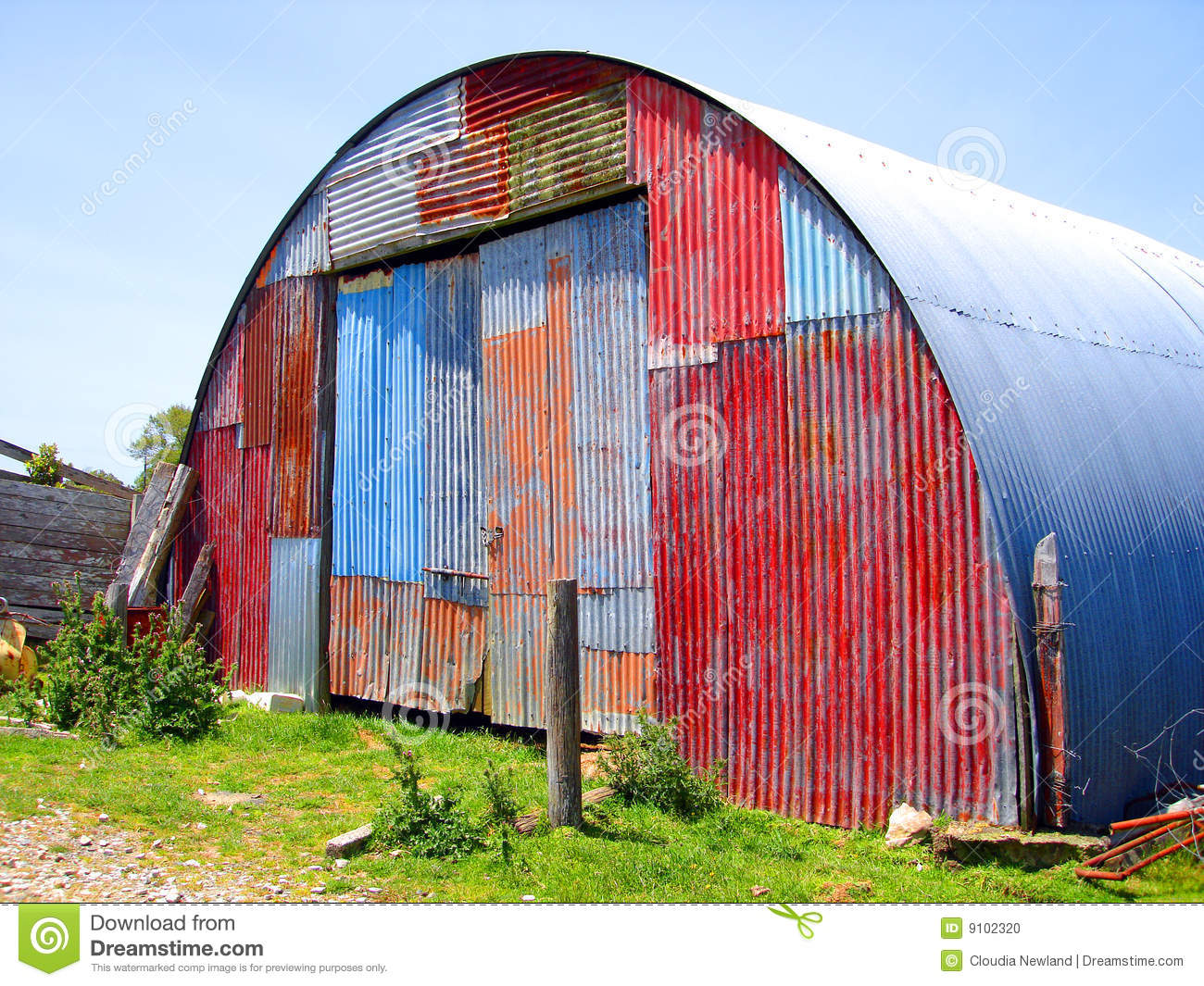 Round Metal Shed With Mismatched Paint Stock Photo Image