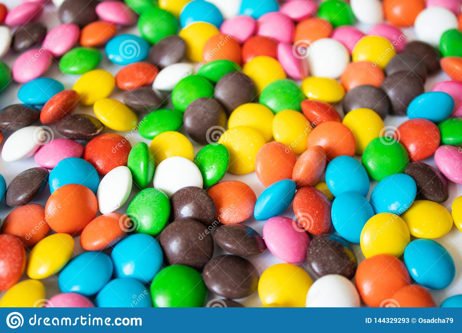 Round, multi-colored, chocolates. A pile of multicolored candies