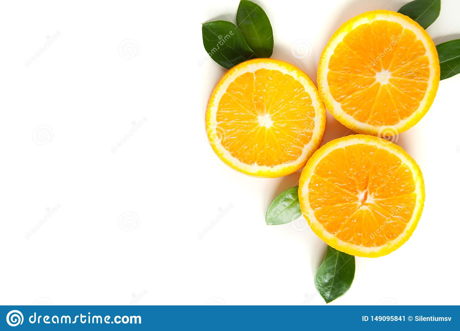 Round orange slices on a white background. Citrus tropical fruit background. Bright food. Dietary vitamin nutrition.