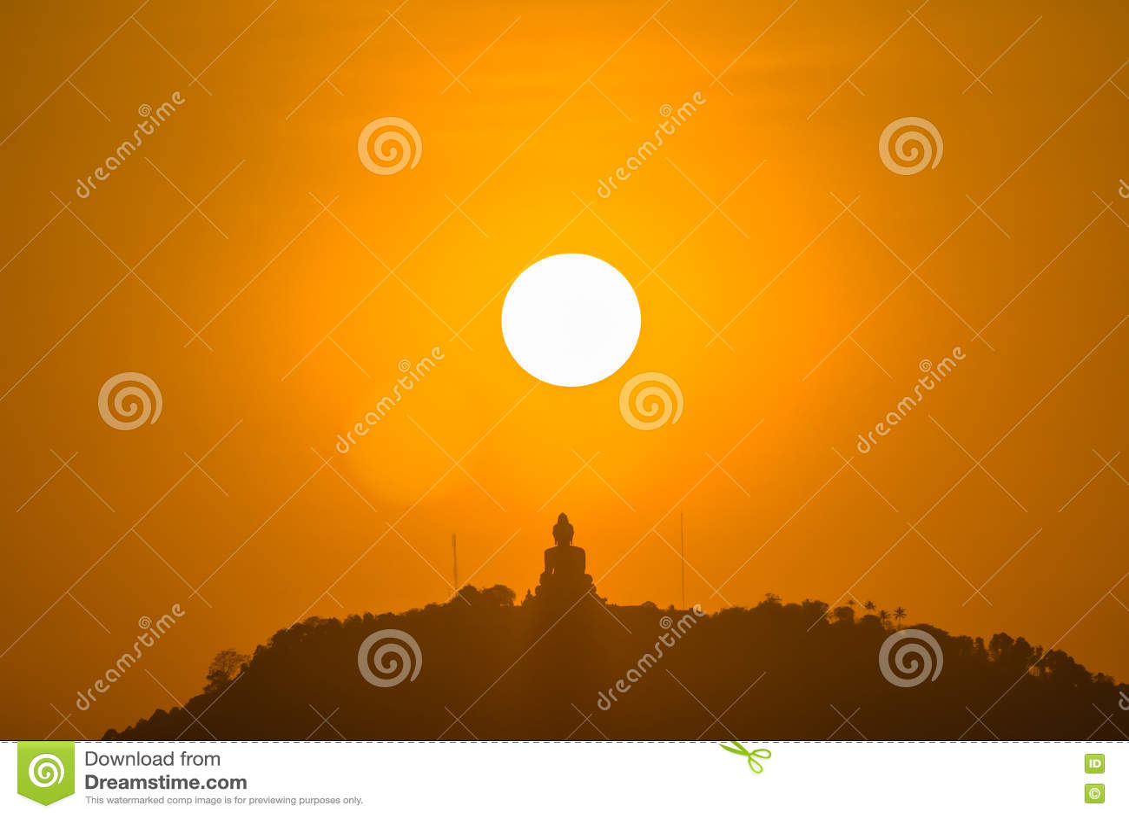 Round red sun above big Buddha