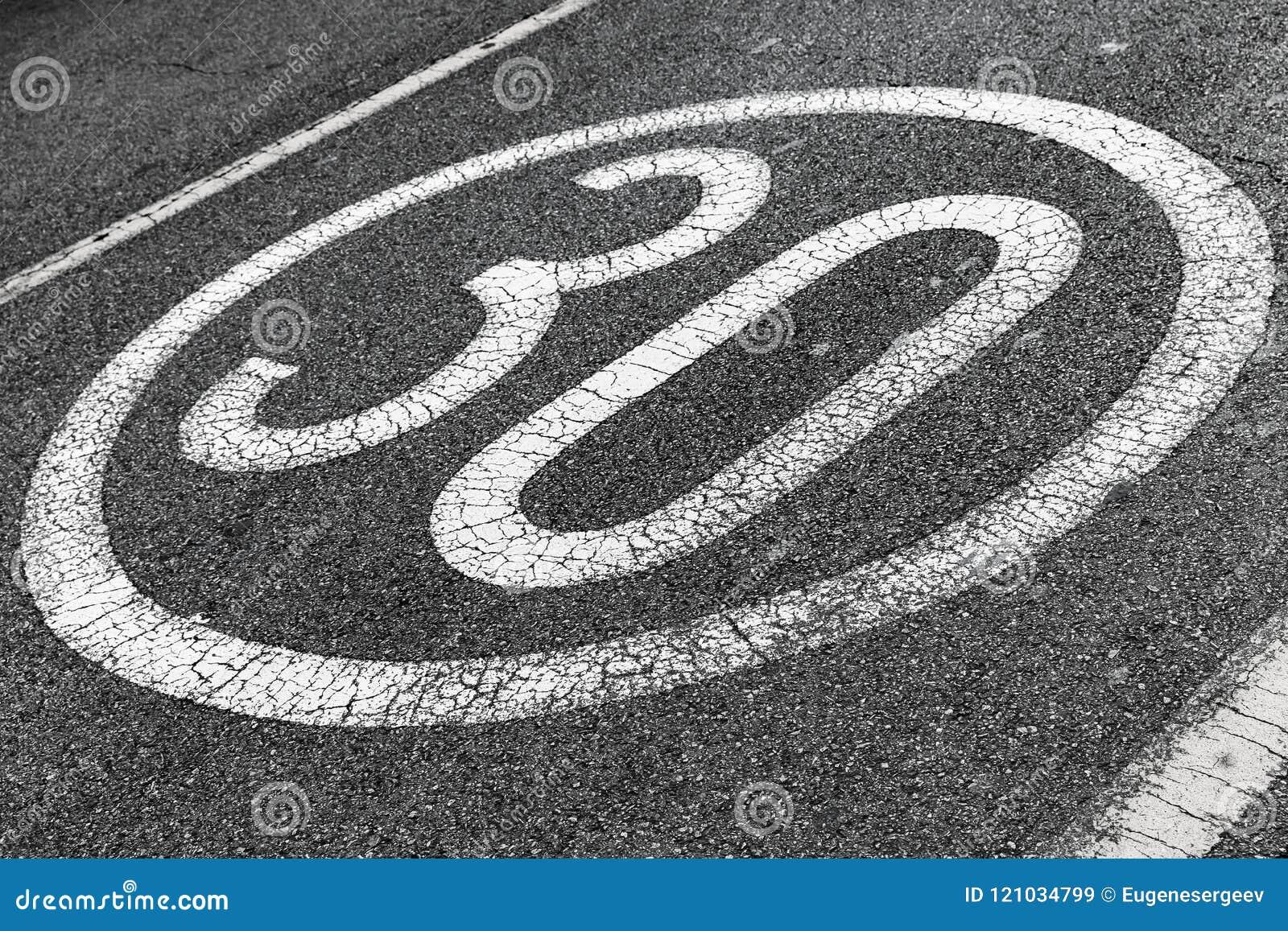 Round speed limit road marking