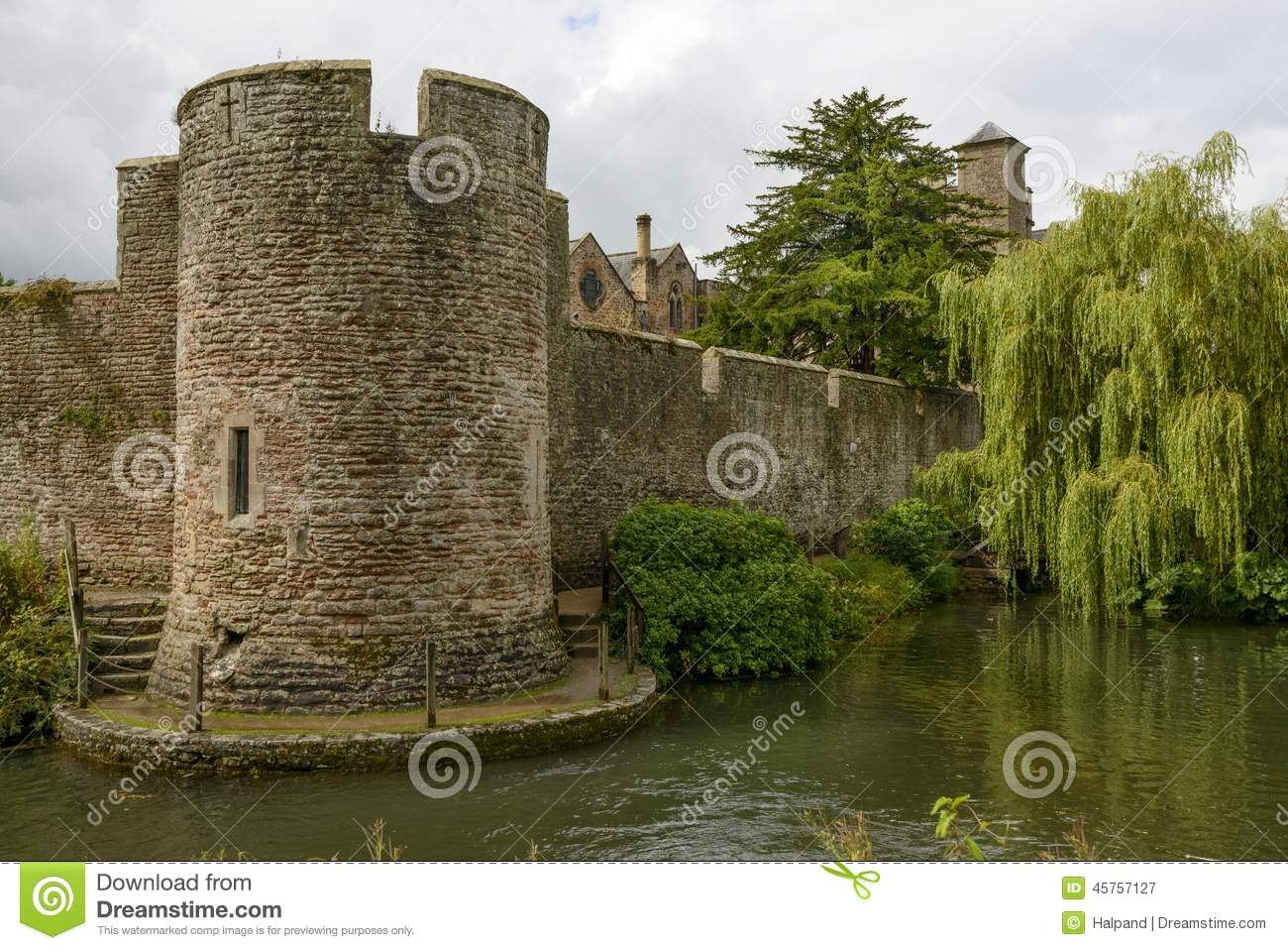 Round tower and willow tree on moat at Bishop palace ,Wells