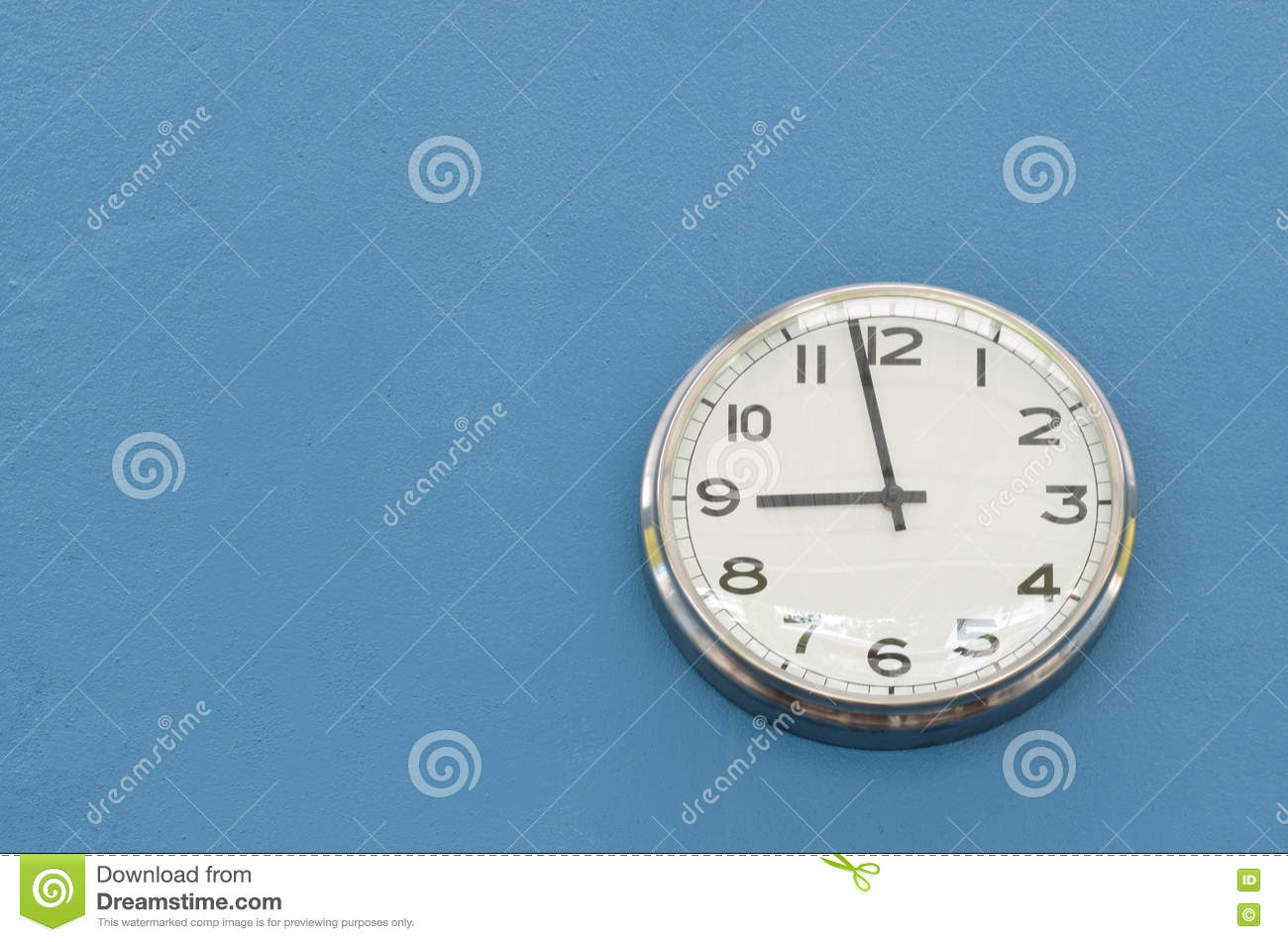 Round Wall Clock Hanging On Blue Cement Wall Stock Image Image Of