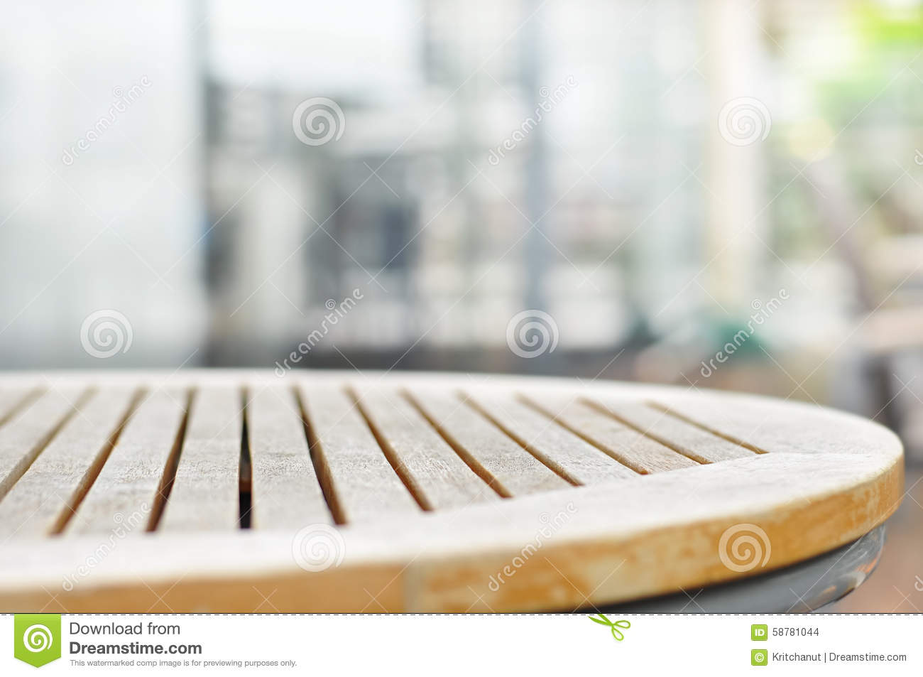 Round wood table top on blur gray background