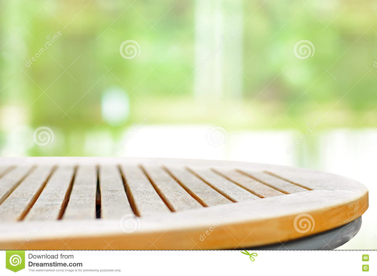 round wood table top on blur light green background stock ph