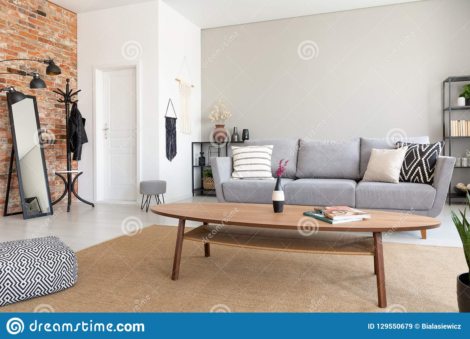Round Wooden Table In The Middle Of Elegant Living Room With