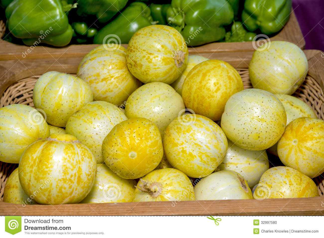 Round Yellow Vegetables In A Basket At A Market Stock ...